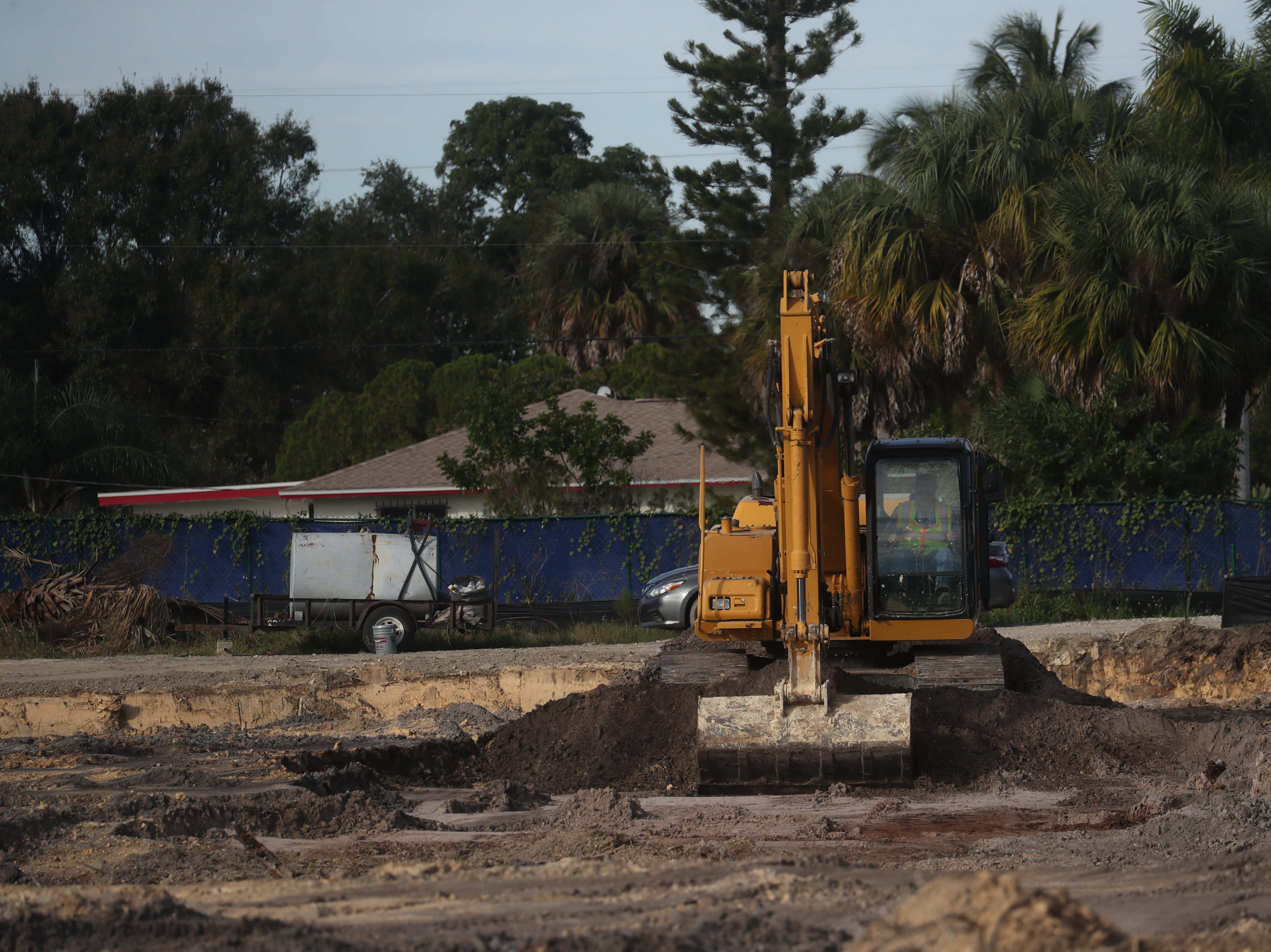 The process to remove toxic sludge from a Fort Myers neighborhood off of South Street has begun. Two trucks containing material from the site left this morning. The sludge will be driven to the  LaFargeHolcim cement plant in Theodore, Alabama,