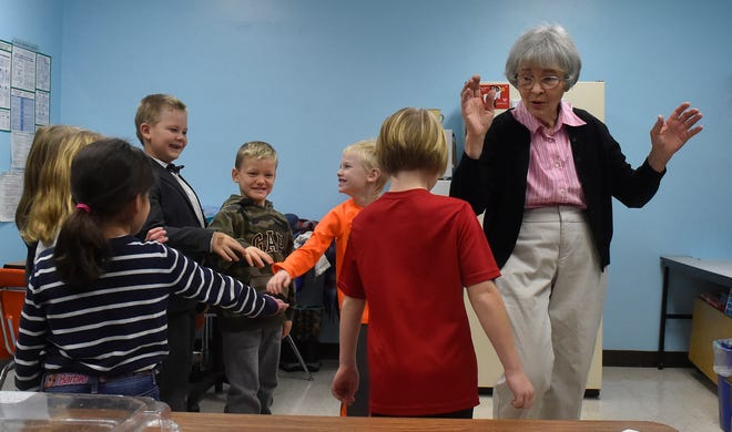 """George Findlay, wearing his favorite bow tie at left, and his first/second grade classmates perform """"The Hokey Pokey'' with music teacher Donna Briesemeister at Washington Island School on Nov. 27, 2018. Tina M. Gohr/USA TODAY NETWORK-Wisconsin"""