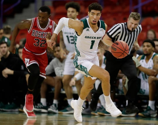 Green Bay Phoenix guard Sandy Cohen III (1) leads a breakaway after a steal against the Northern Illinois Huskies in a NCAA men's basketball game at the Resch Center on Wednesday, November 28, 2018 in Ashwaubenon, Wis.