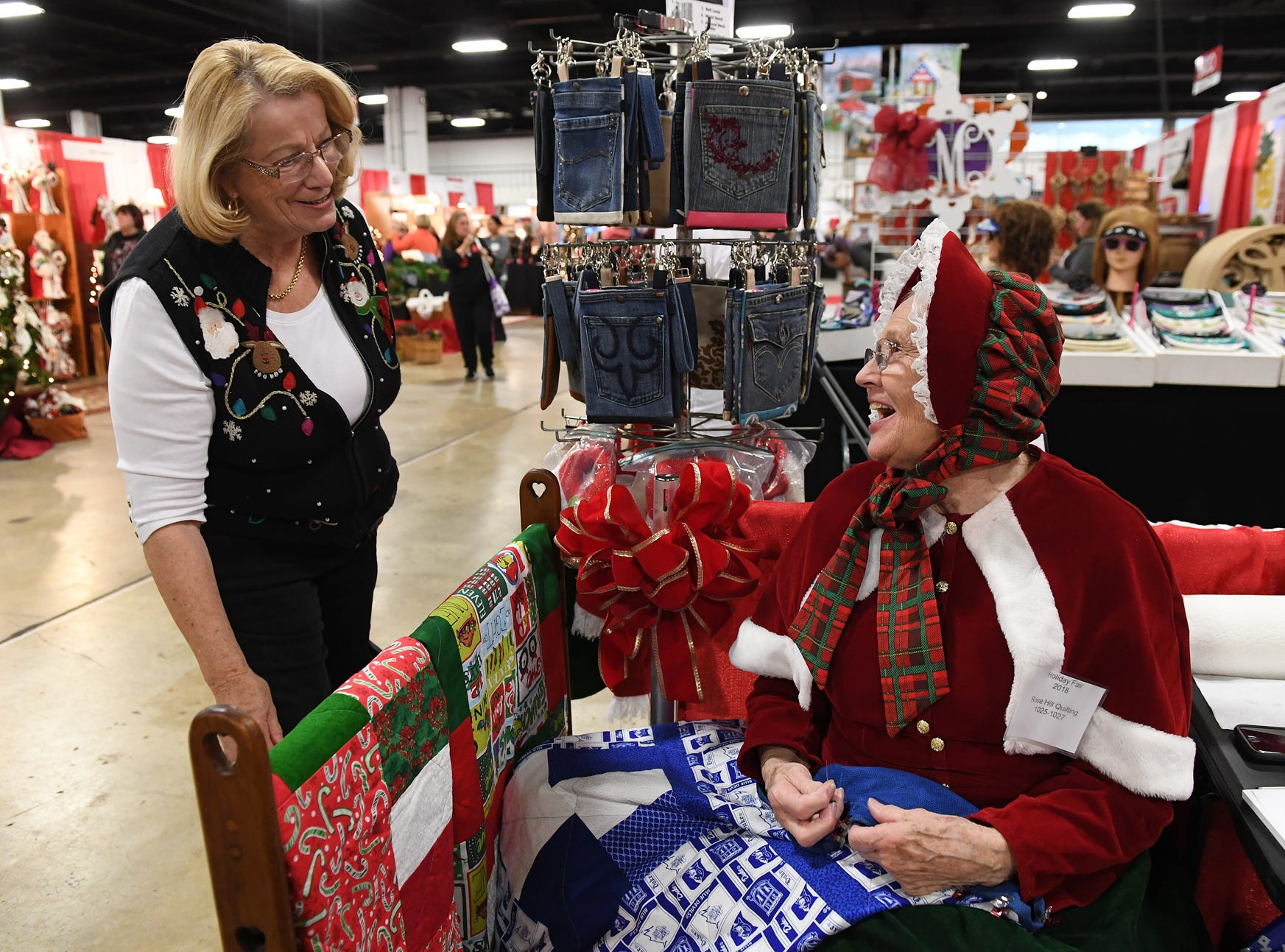 Ella Lockhart, right, talks with Cindi Ballard while quilting in her booth at the 48th annual Holiday Fair at the Greenville Convention Center Thursday, November 29,  2018.