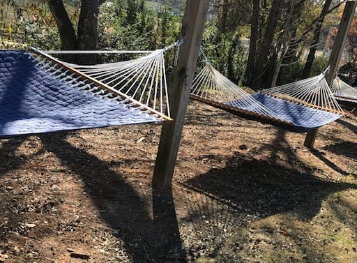 Outside, you'll find a green space for lounging, including hammocks.