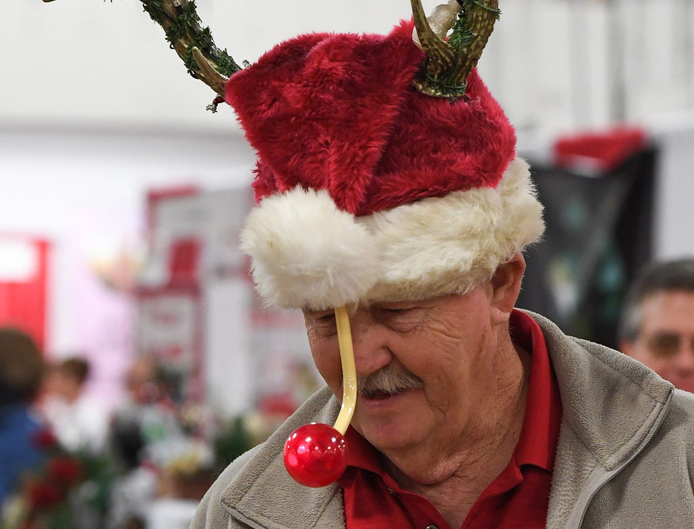 Don Manus wears his unique Christmas hat while attending the 48th annual Holiday Fair at the Greenville Convention Center Thursday, November 29,  2018.