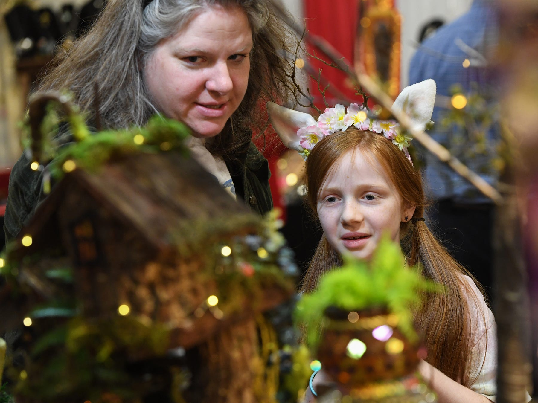 Elizabeth Clarke looks at a display with her mother Sara during the 48th annual Holiday Fair at the Greenville Convention Center Thursday, November 29,  2018.
