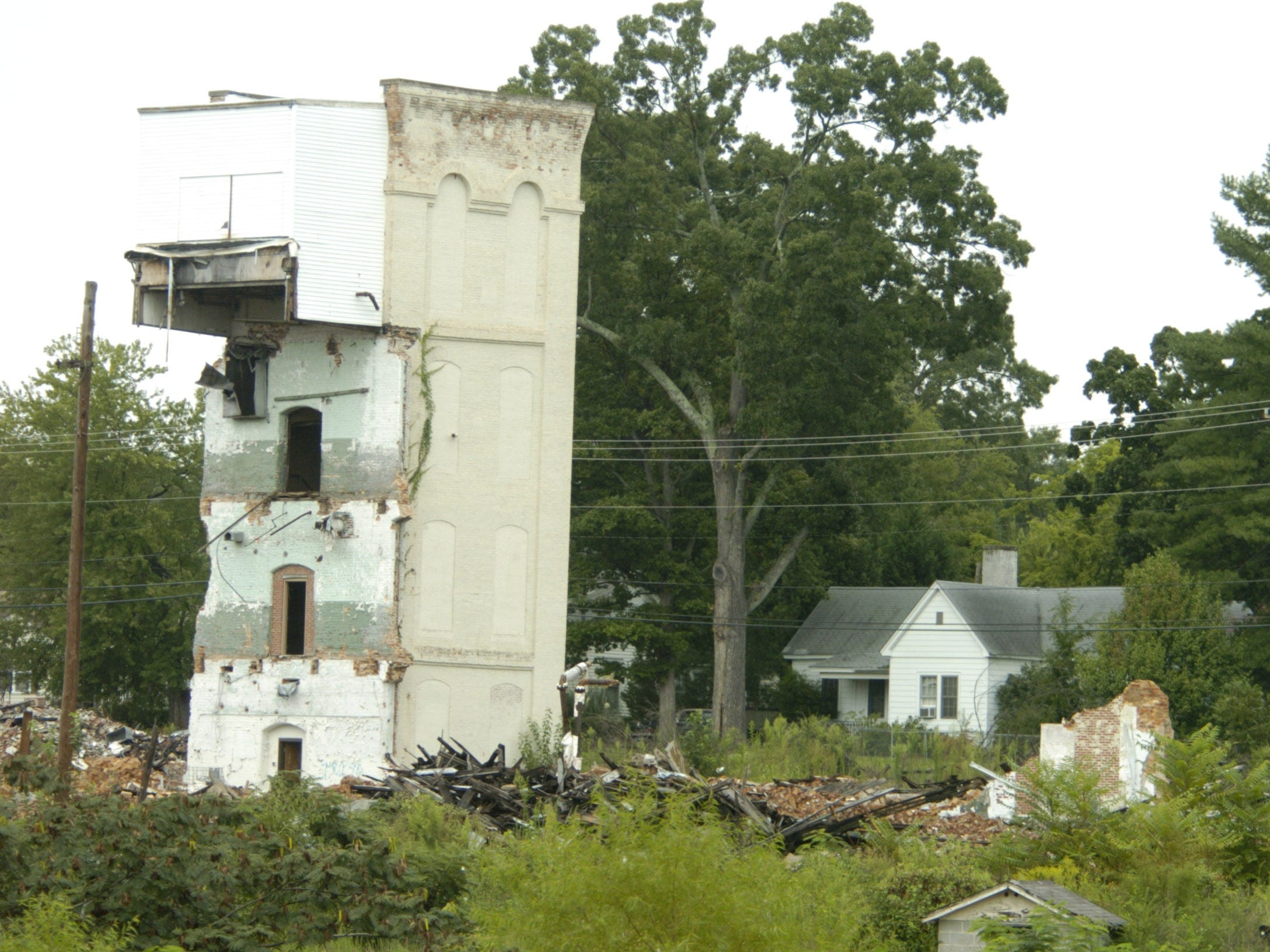 Houses on Victor Ave. in Greer, SCX, look over the remains on Victor Mill in this archive photo from September 2006.