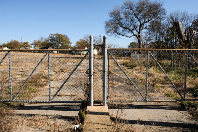 A chain link fence surrounds the site of the old Victor Mill in Greer, where a developer plans to build a mix of apartments, town houses and single-family homes.