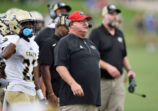 Greer High defensive coordinator Travis Perry, shown during the Yellow Jackets' season opener against Byrnes, missed five games after undergoing surgery Sept. 18.