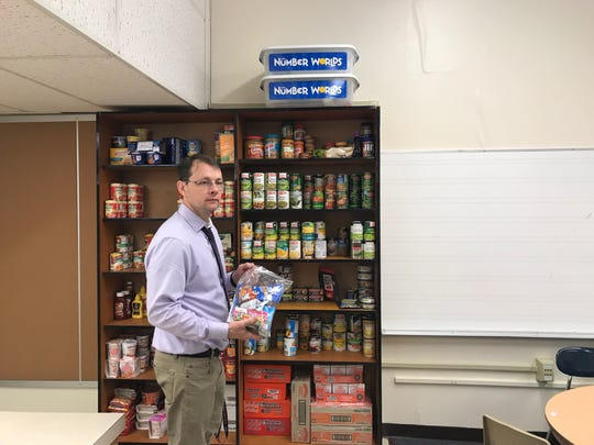 Principal Ingalls explaining the food pantry and donations