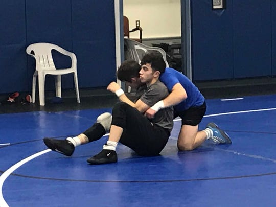 Havre senior Martin Wilkie, in front, works with junior Connor Harris in preparation for the Havre Invitational Tournament Friday and Saturday at the Havre gym. Wilkie is a three-time state champion for the Blue Ponies.