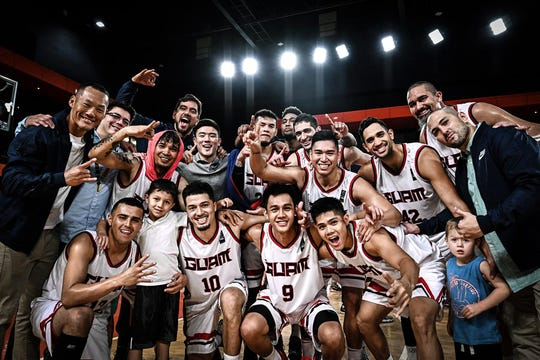 Team Guam celebrates a win over Thailand in the FIBA Asia Cup 2021.