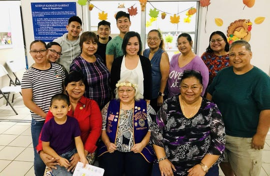 The Guahan Isan Famagu'on Lions Club of LCI District 204, in conjunction with the District's hunger relief program, provided meals for the homeless at Kamalen Karidat in Hagatna on Nove. 14. Seated from left: Gaj Quichocho-Gonzales (on lap), and Lions Patti Quichocho, LCI District 204 GST and President Ewy Taitano MJF, and Yvonne Toves. Middle row from left: Lions Erin, Ratuyan, Maria Agulto, Tina Alan, Lorenza Muna, Julie Garcia MJF, and Annie Pineda. Back row from left: Lion Ewy Cepeda; UOG  SO202 students - Raven Taitague, Tyler Salas, and Matthew LIm; and Lion Dr. Matilda Naputi Rivera. Not pictured: Lions Rodney Ratuyan, Rodney Cepeda, and Prospective Lion Roy Toves.