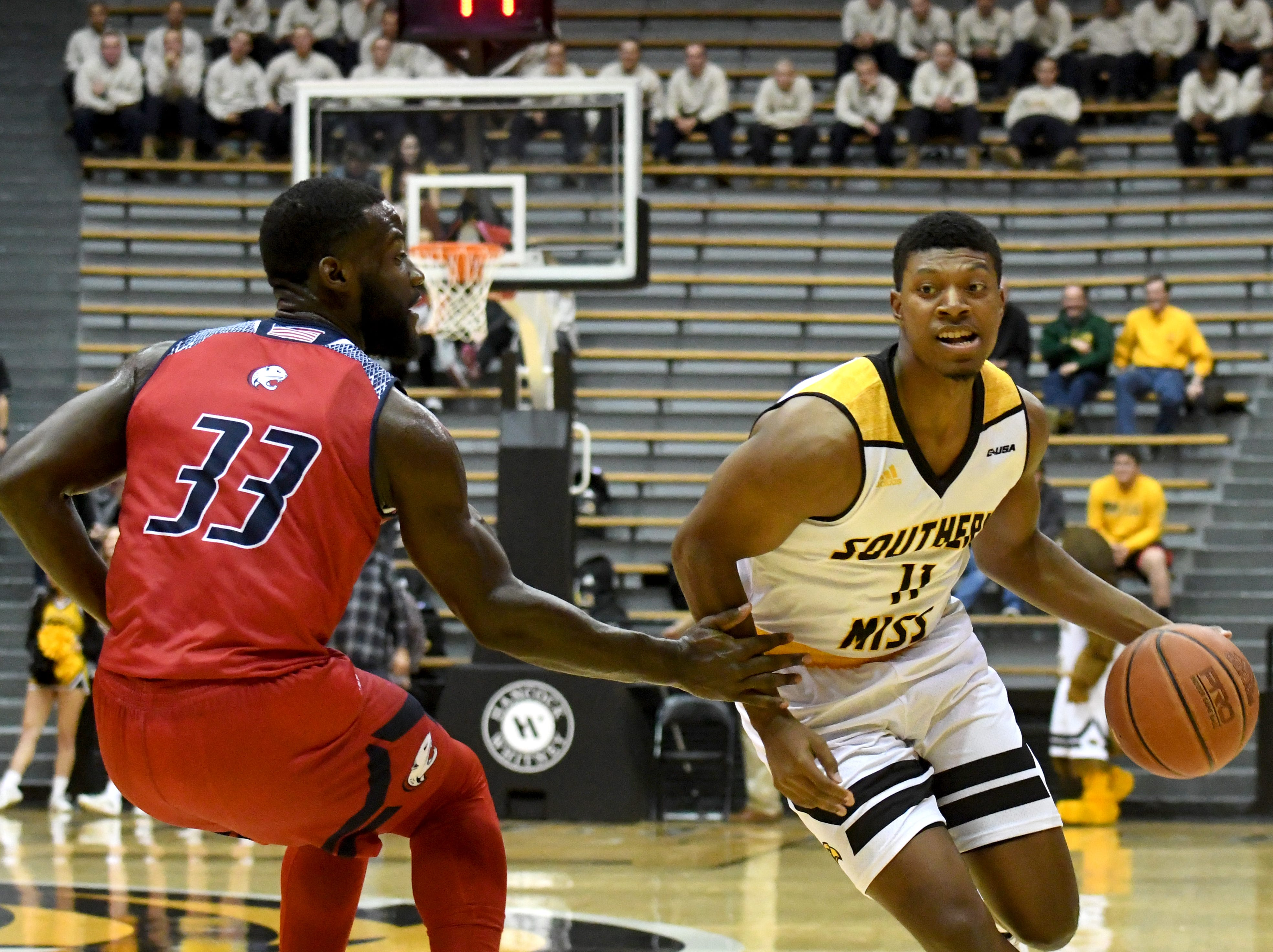 Southern Miss guard Ladavius Draine passes a defender in a game against South Alabama in Reed Green Coliseum on Wednesday, November 28, 2018.
