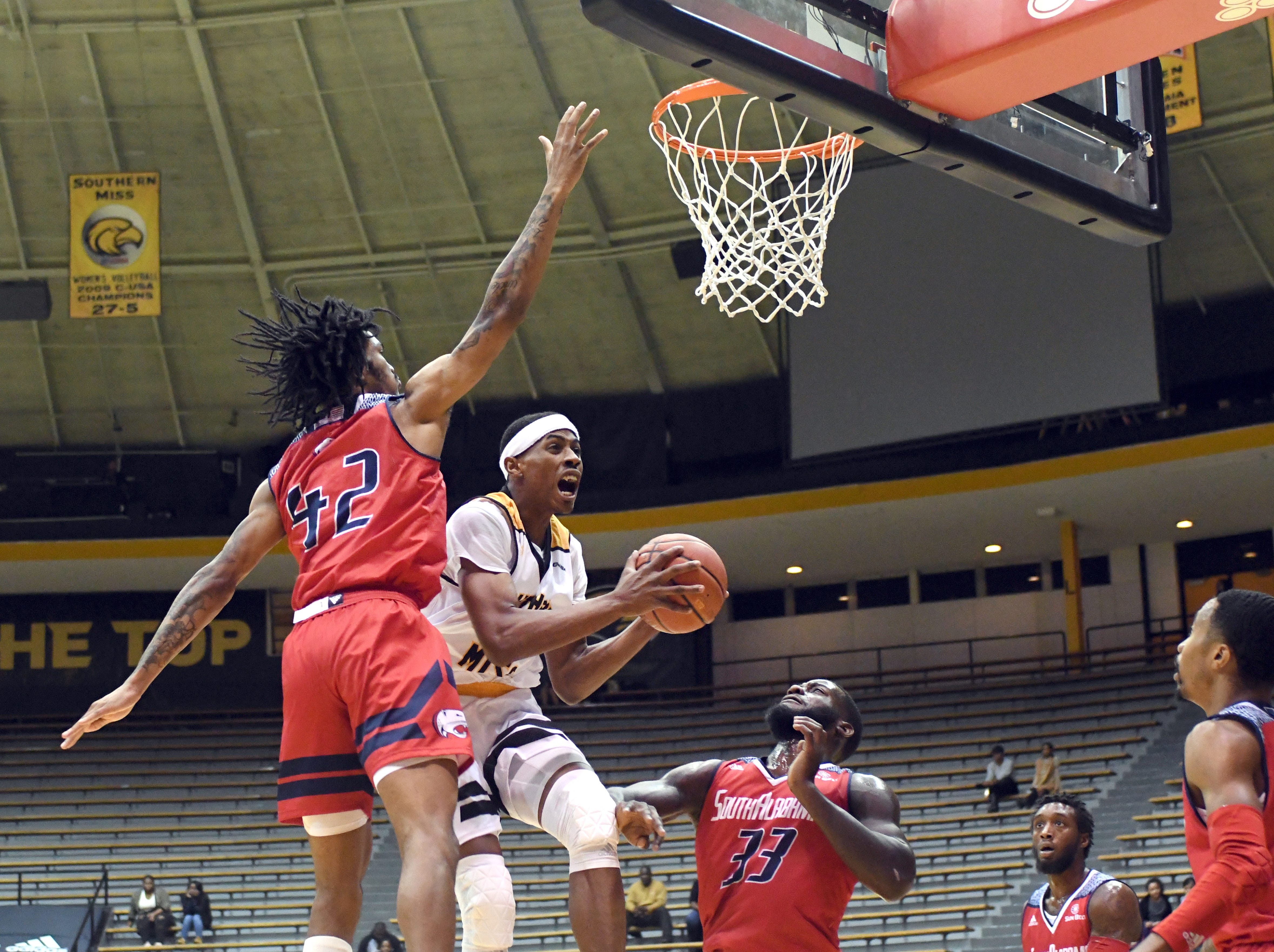 Southern Miss forward Leonard Harper-Baker shoots for the basket in a game against South Alabama in Reed Green Coliseum on Wednesday, November 28, 2018.