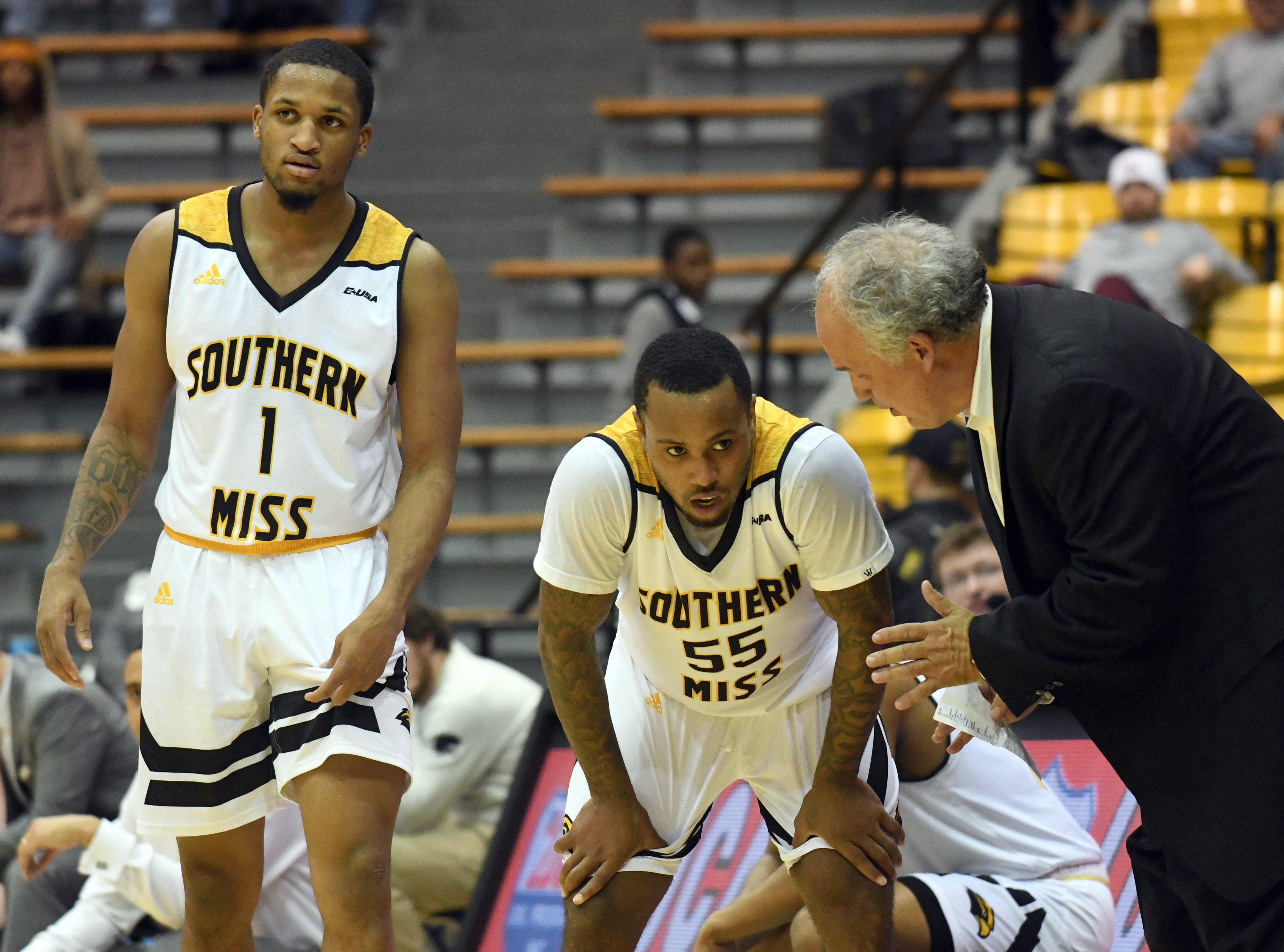 Southern Miss head coach Doc Sadler speaks with guard Tyree Griffins in a game against South Alabama in Reed Green Coliseum on Wednesday, November 28, 2018.