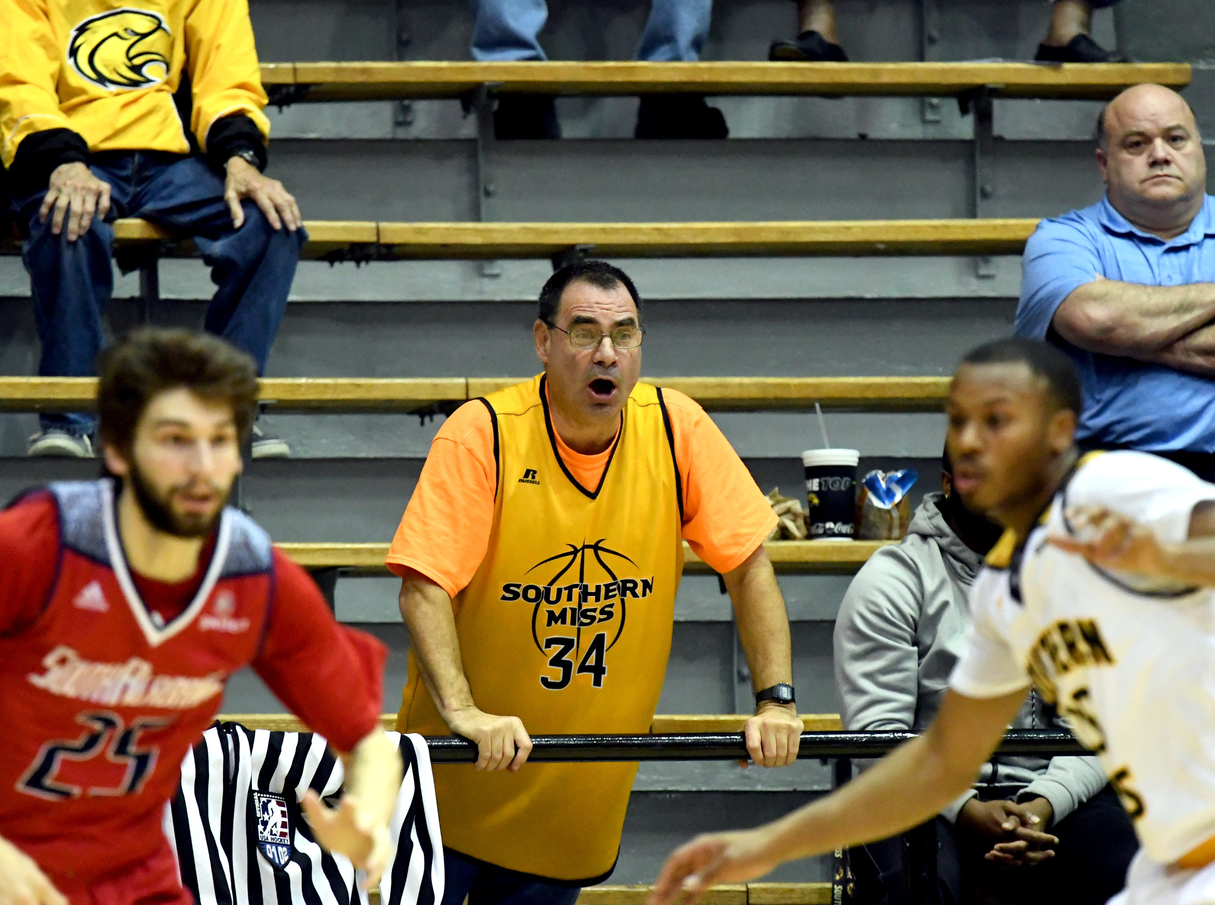 A Southern Miss fan cheers on his team in a game against South Alabama in Reed Green Coliseum on Wednesday, November 28, 2018.