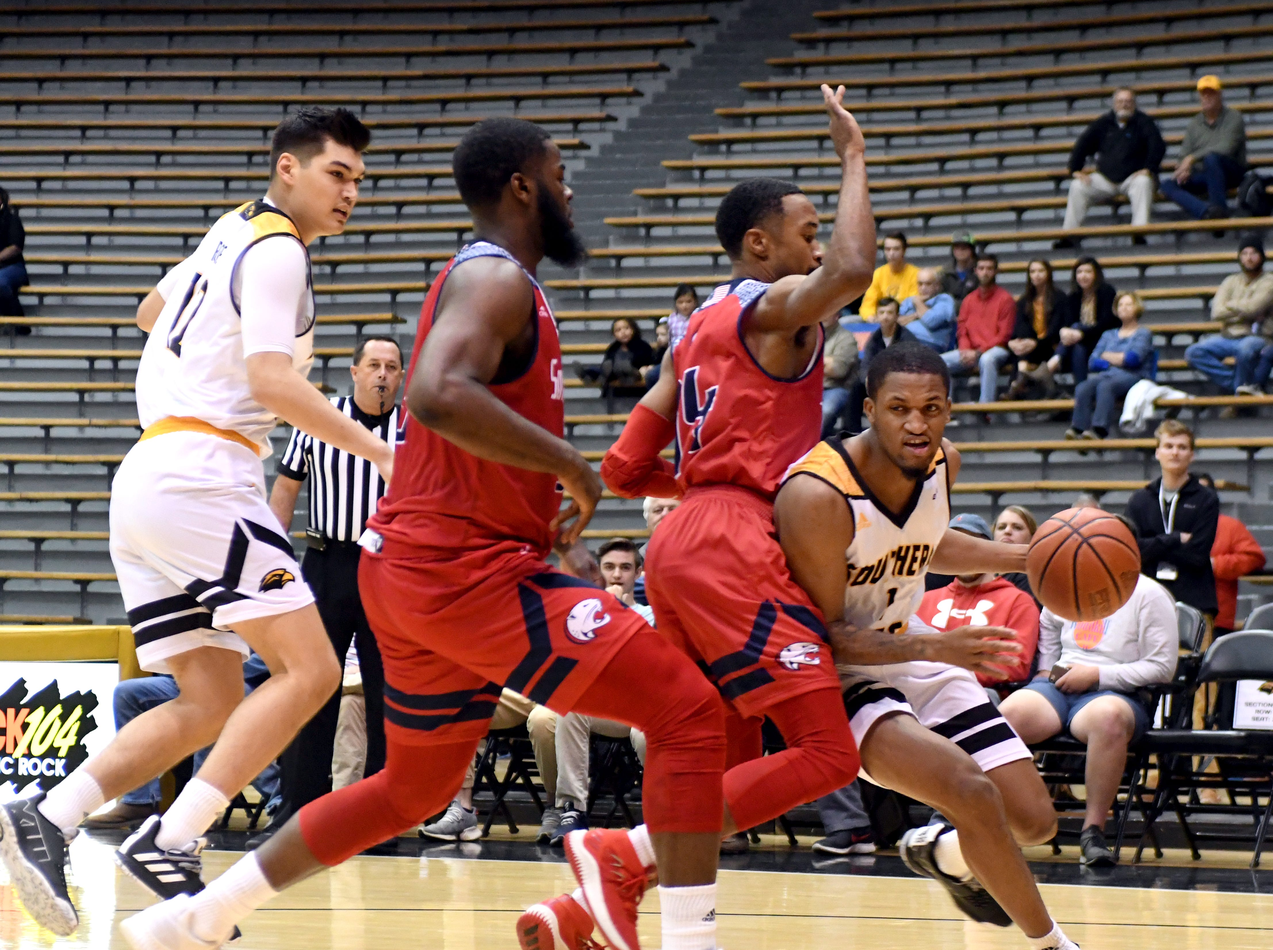 Southern Miss guard Cortez Edwards fights past a defender in a game against South Alabama in Reed Green Coliseum on Wednesday, November 28, 2018.