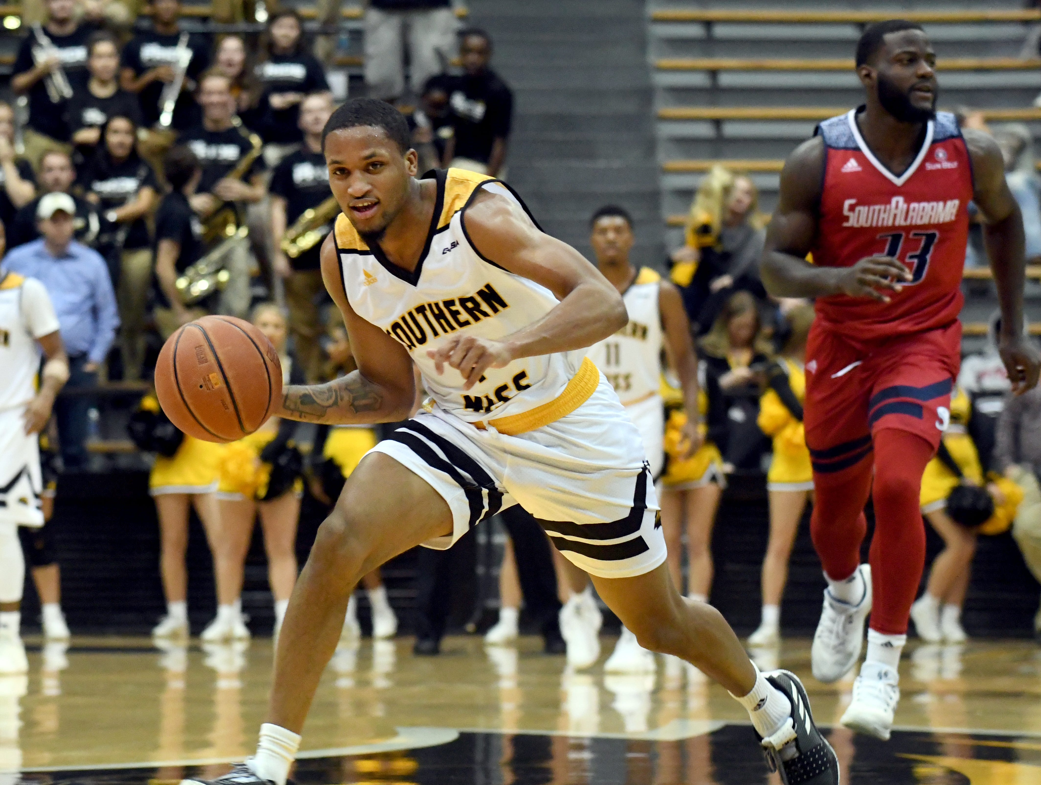 Southern Miss guard Cortez Edwards steals the ball in a game against South Alabama in Reed Green Coliseum on Wednesday, November 28, 2018.