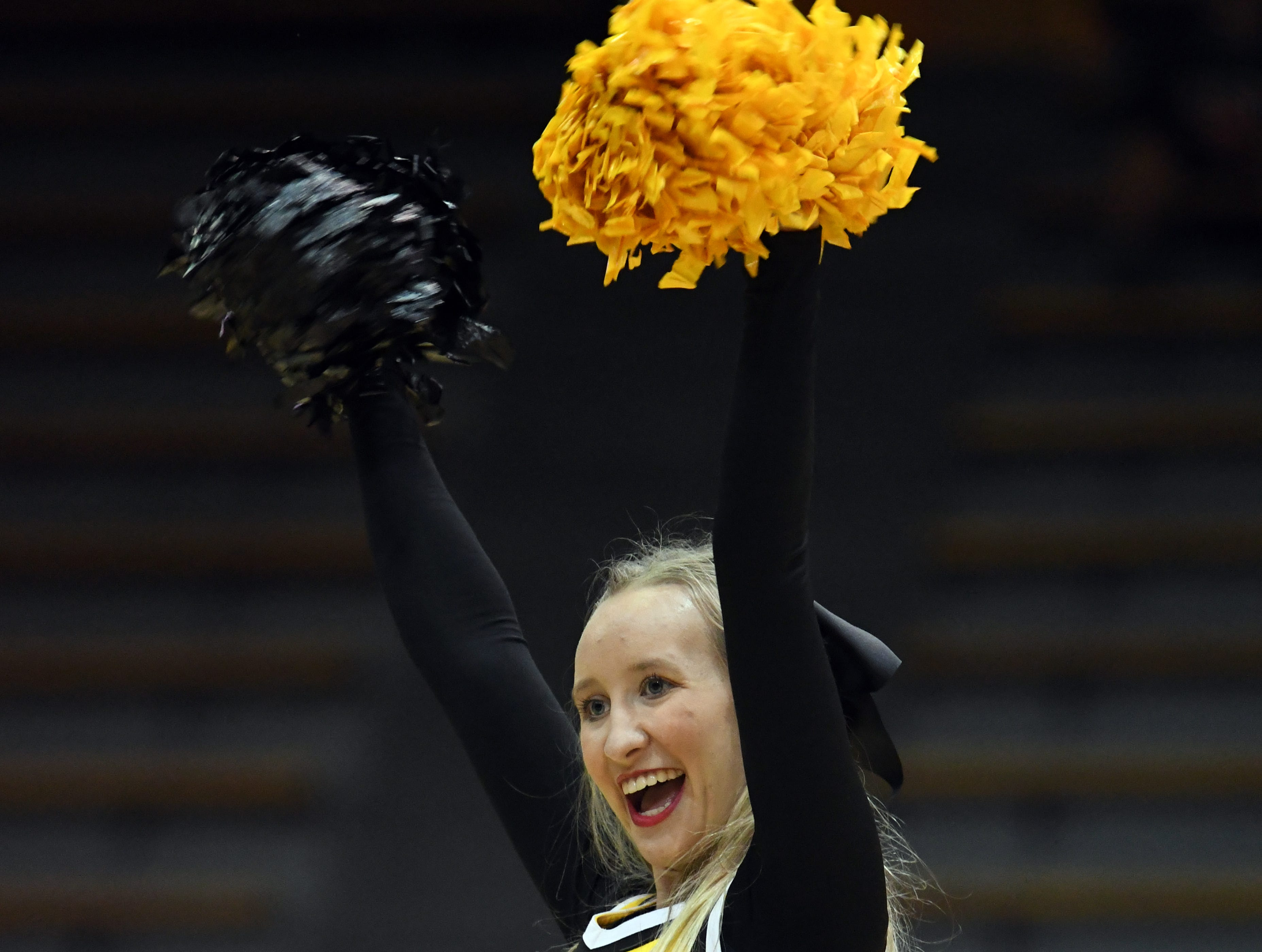 A Southern Miss cheerleader performs prior to the game against South Alabama in Reed Green Coliseum on Wednesday, November 28, 2018.