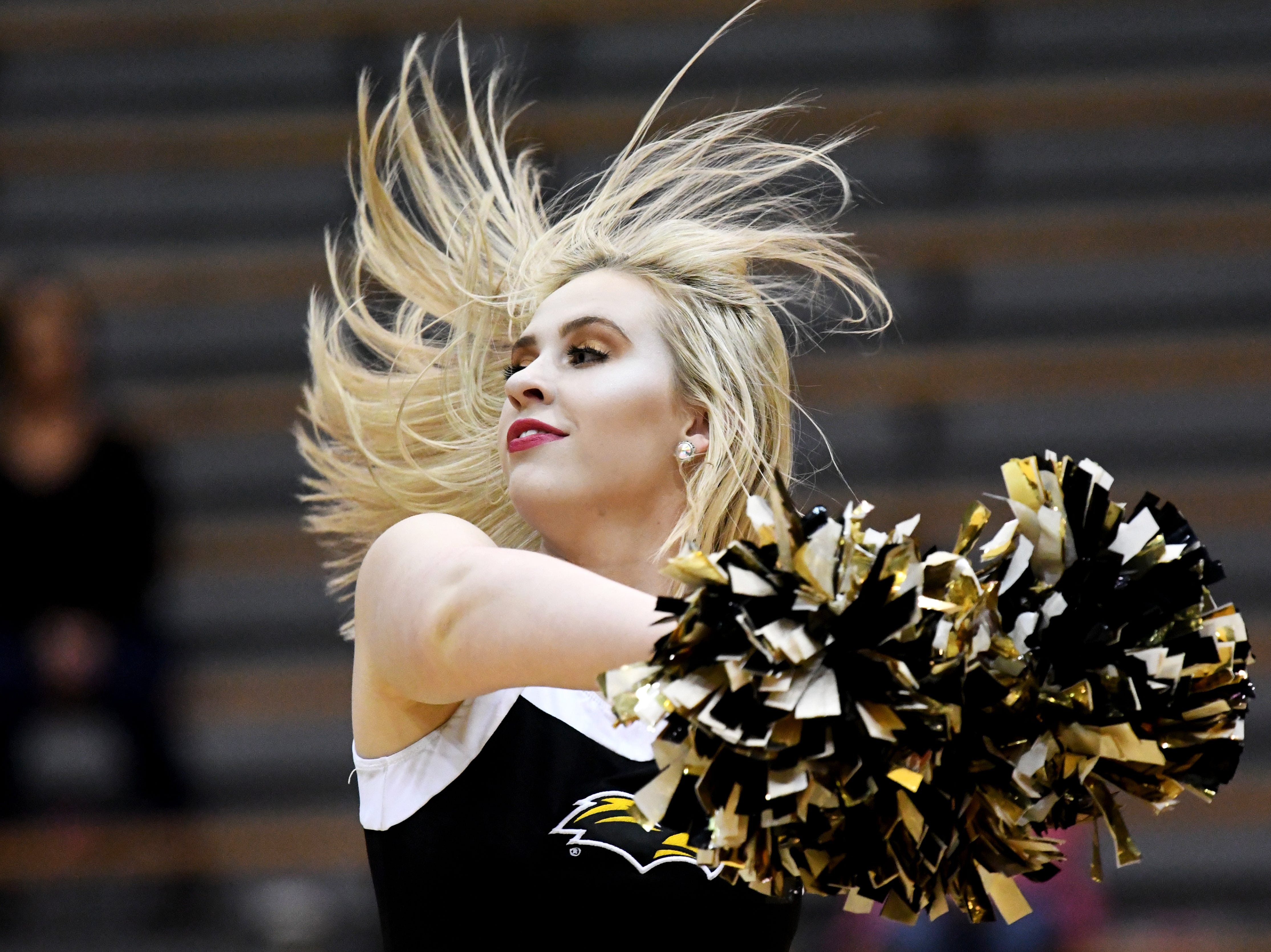 A Southern Miss dancer performs during a timeout in a game against South Alabama in Reed Green Coliseum on Wednesday, November 28, 2018.