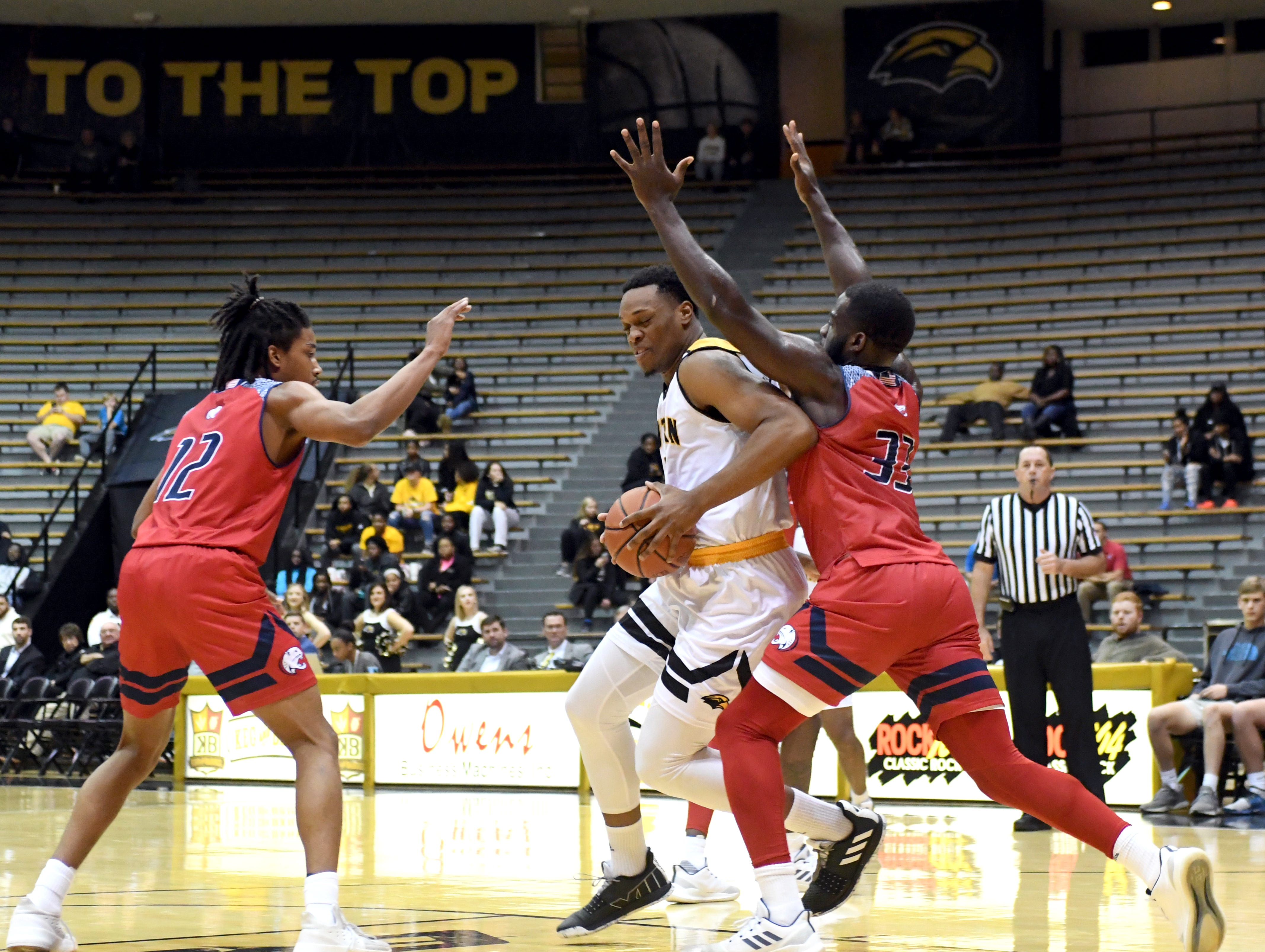 Southern Miss forward Boban Jacdonmi fights off a defender in a game against South Alabama in Reed Green Coliseum on Wednesday, November 28, 2018.