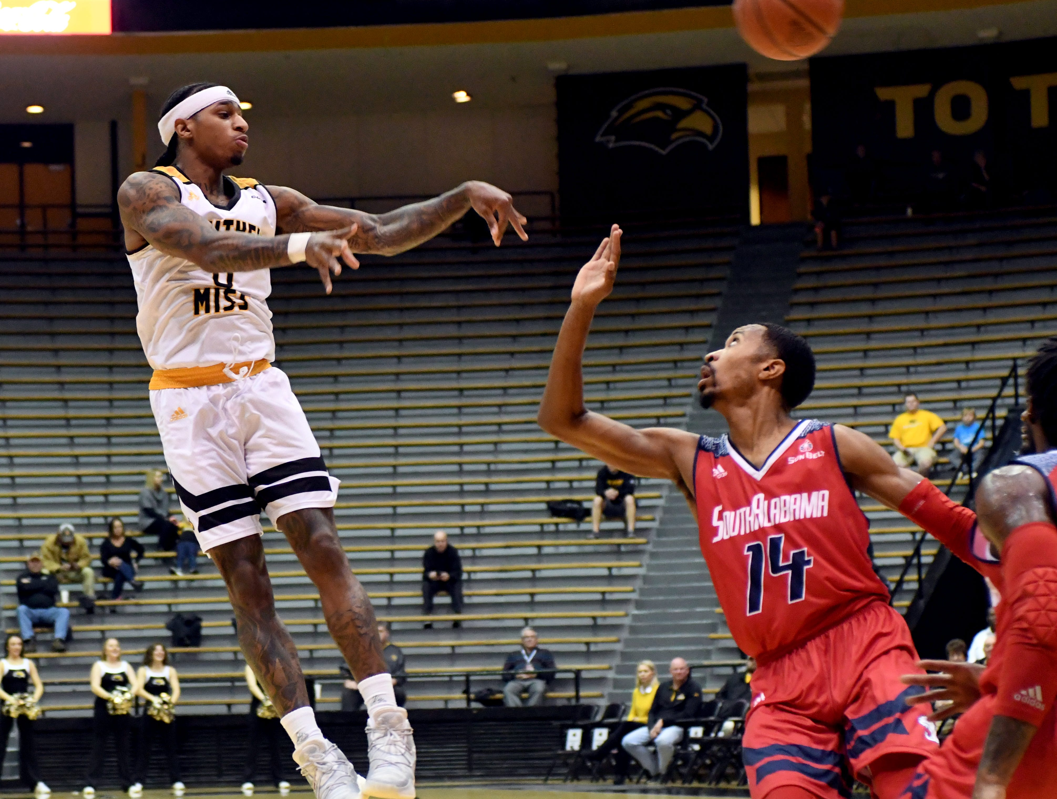 Southern Miss guard Dominic Magee passes the ball to his teammate in a game against South Alabama in Reed Green Coliseum on Wednesday, November 28, 2018.