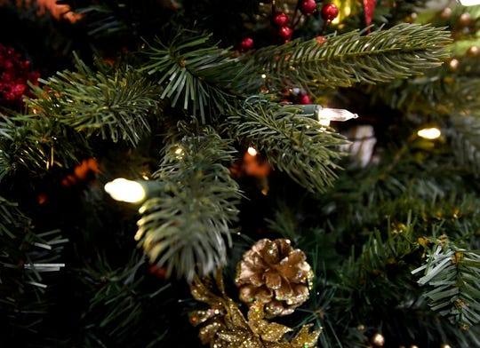 Artificial trees, fans say, cost less because they can be used year after year, and they don't cause allergic reactions as some live trees do.