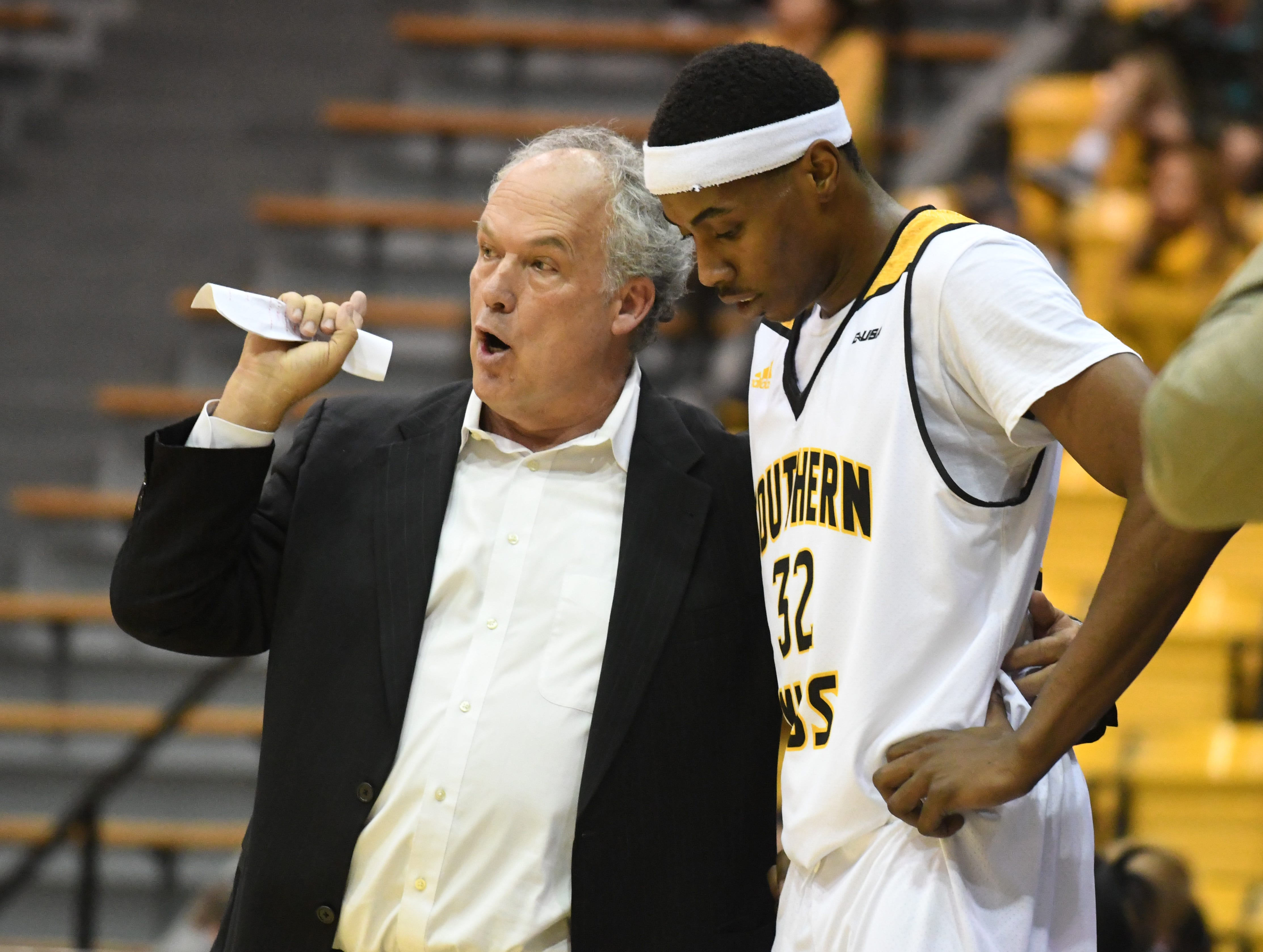 Southern Miss head coach Doc Sadler speaks with forward Leonard Harper-Baker shoots for the basket in a game against South Alabama in Reed Green Coliseum on Wednesday, November 28, 2018.