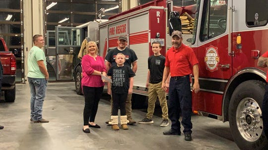 Eight-year-old Harlie Williams, who was diagnosed last year with Ewing sarcoma, was the recipient of this year's Hattiesburg Fire Department No Shave November fundraiser. Her family was presented a check for $1,400 Wednesday, Nov. 28, 2018, at Fire Station 1.