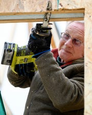 Chester Watson, a Habitat for Humanity crew member, uses a new reciprocating saw to cut a doorway into a two bedroom house being built on Collier Road in Henderson, Ky., Thursday, Nov. 29, 2018. Field & Main Bank and community members rallied together to replace roughly $10,000 worth of tools that were stolen from another home-build site earlier in the week.