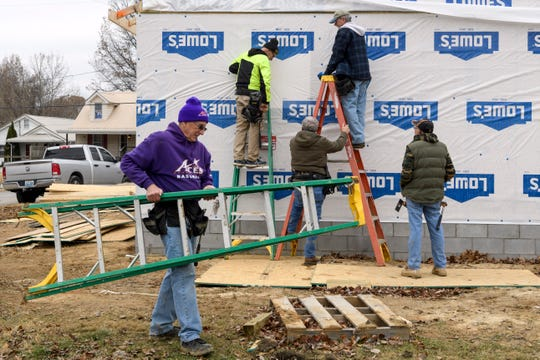 Habitat for Humanity crew members Lee Obenchain, left to right, Rick Motter, Chester Watson, Mike Thurman and Jack Drury work on a home-build on Collier Road in Henderson, Ky., Thursday, Nov. 29, 2018.