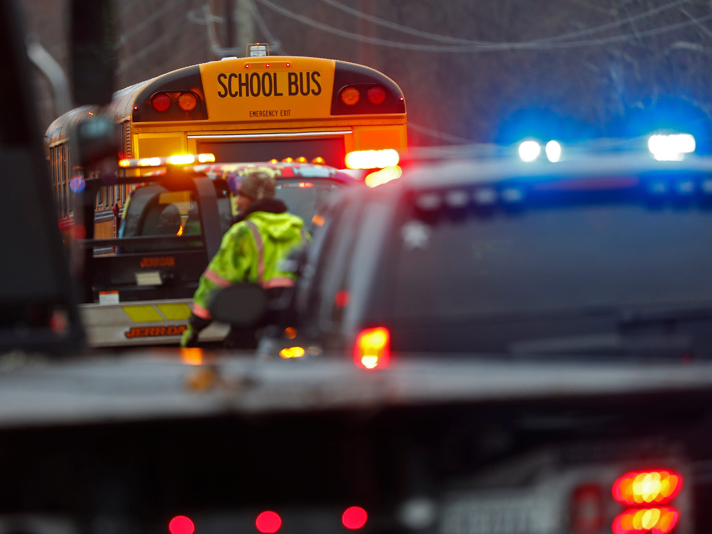 A school bus was brought to the scene for people waiting for their cars to be towed, as clean-up continues after a multi-car pileup due to slick conditions, on 96th St. near Hazel Dell Parkway, Thursday, Nov. 29, 2018.