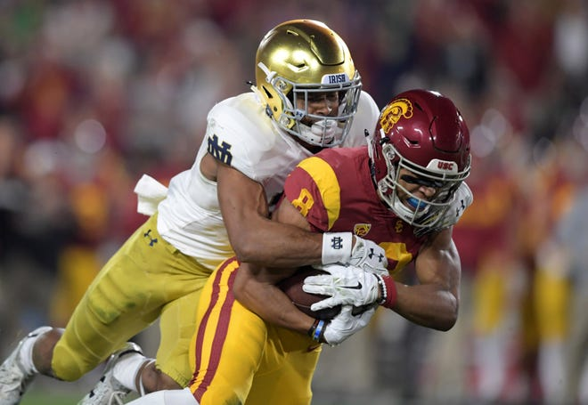Trojans wide receiver Amon-Ra St. Brown (8) is defended by Notre Dame Fighting Irish cornerback Julian Love (27) in the first quarter at Los Angeles Memorial Coliseum.