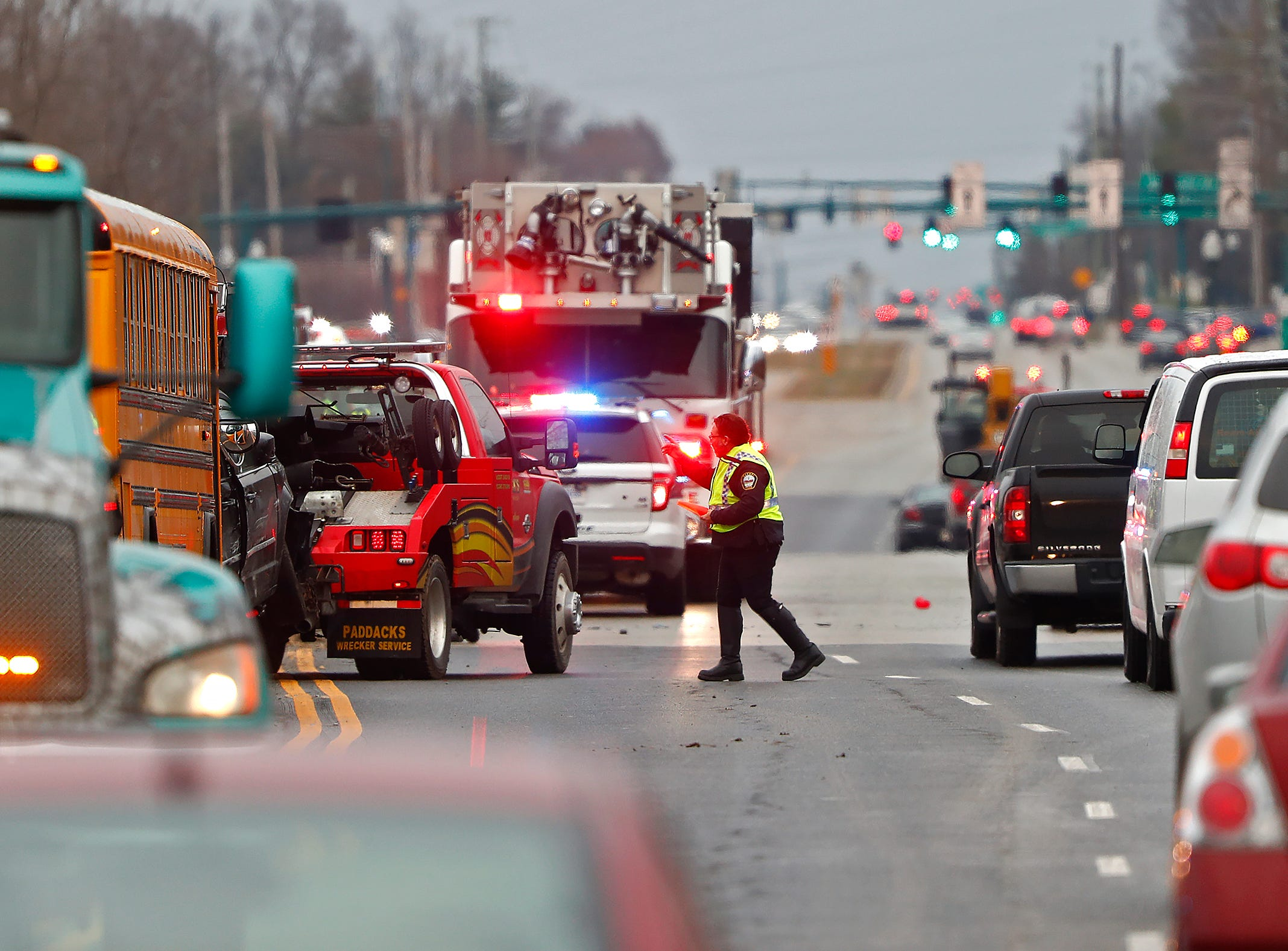 Traffic continues eastbound, as clean-up continues after a multi-car pileup due to slick conditions, on 96th St. near Hazel Dell Parkway, Thurssday, Nov. 29, 2018.
