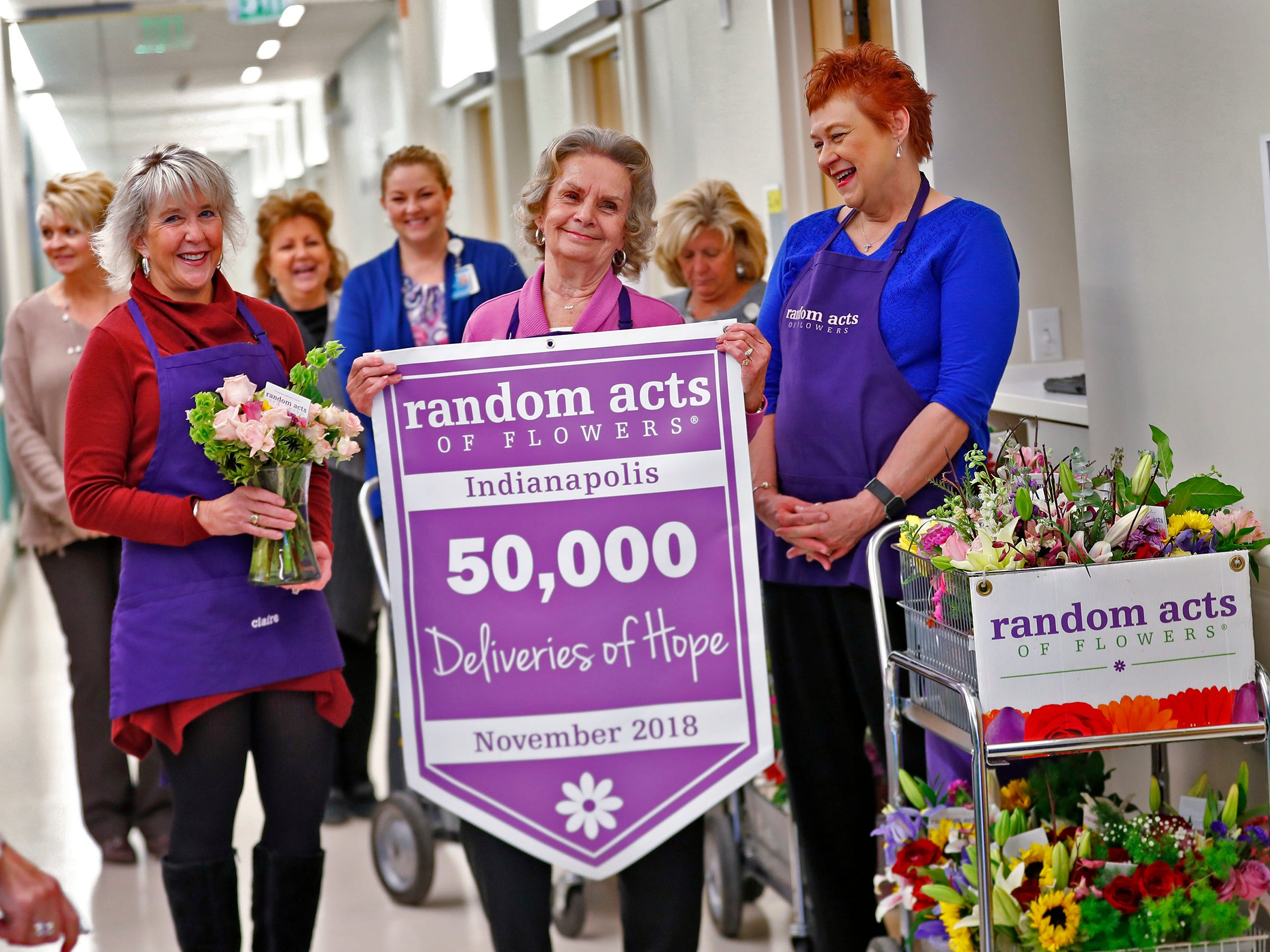 Claire Alexander, from left, Joan Perry, and Kathy Bradfield, with Random Acts of Flowers, get ready to deliver their 50,000th bouquet of flowers at Sidney & Lois Eskenazi Hospital, Thursday, Nov. 29, 2018.  The newest branch of the national floral nonprofit has been delivering the flowers to patients to offer hope, encouragement and smiles, for about two years.