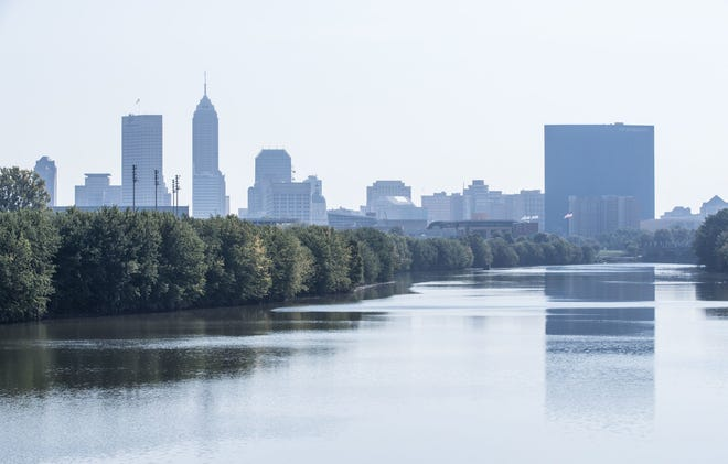 The Indianapolis skyline reflects on the White River on Thursday, Sept. 20, 2018.