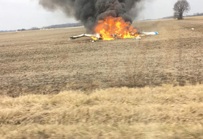 A plane crashed and caught fire in a field just south of the Marion Municipal Airport in Marion, Ind., on Thursday, Nov. 29, 2018.