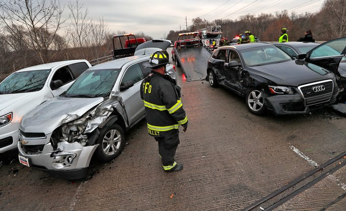 Clean-up continues after a multi-car pileup due to slick conditions, on 96th St. near Hazel Dell Parkway, Thursday, Nov. 29, 2018.
