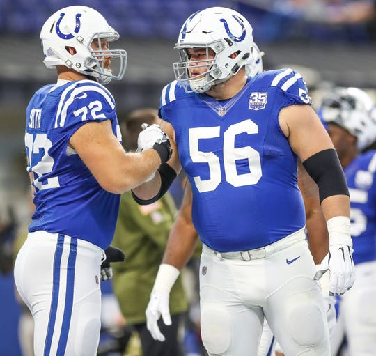 Colts offensive guard Quenton Nelson (56) heads onto the field with offensive tackle Braden Smith (72) at Lucas Oil Stadium on Nov. 11, 2018. They are part of a stacked offensive line that is still a draft priority.