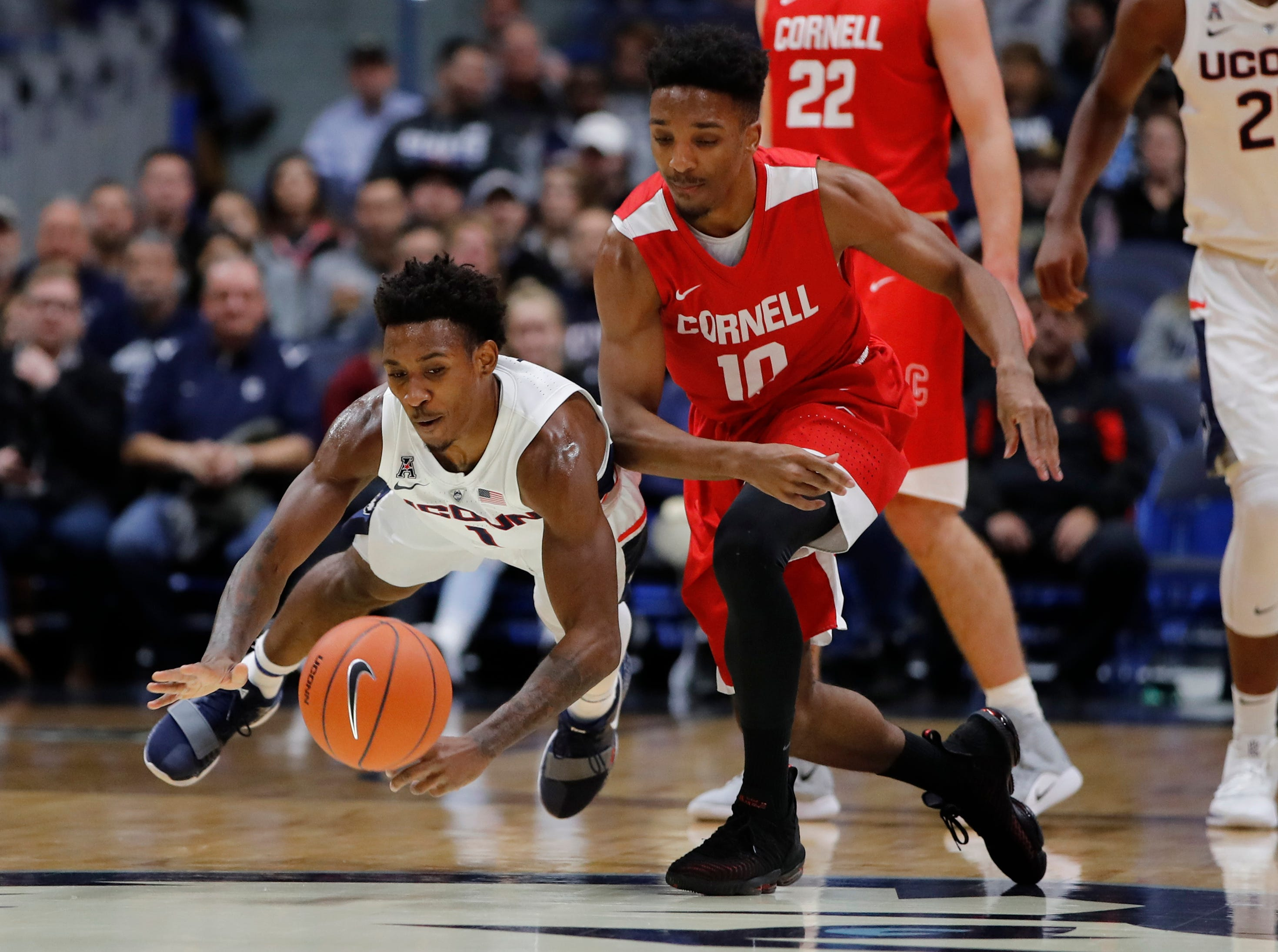 Nov 20, 2018; Storrs, CT, USA; Connecticut Huskies guard Christian Vital (1) and Cornell Big Red guard Matt Morgan (10) chase a loose ball in the first half at XL Center. Mandatory Credit: David Butler II-USA TODAY Sports
