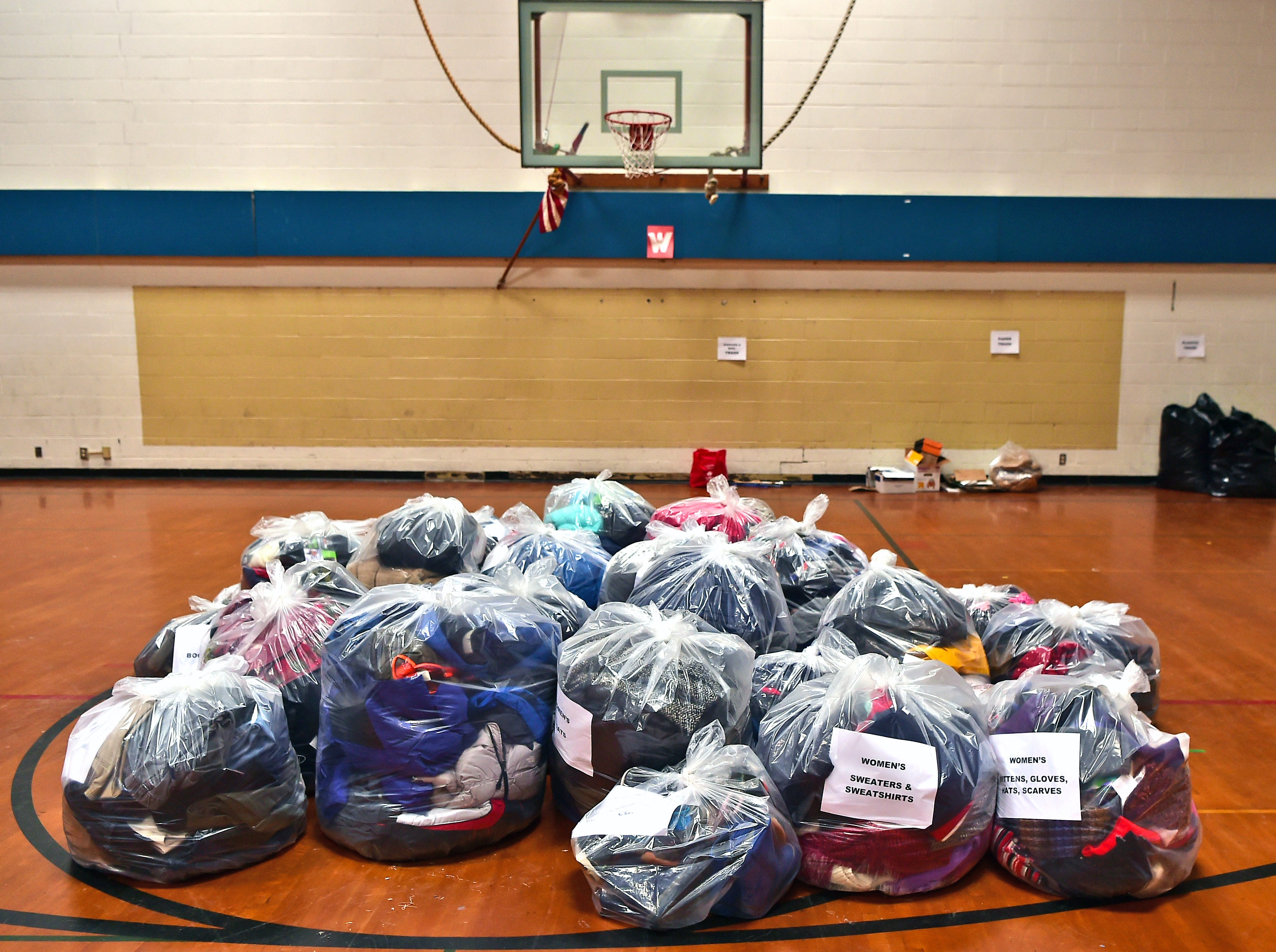 Catholic Charities of Tompkins/Tioga staff and volunteers work at readying winter clothing donations in Ithaca on Thursday, November 29, 2018.