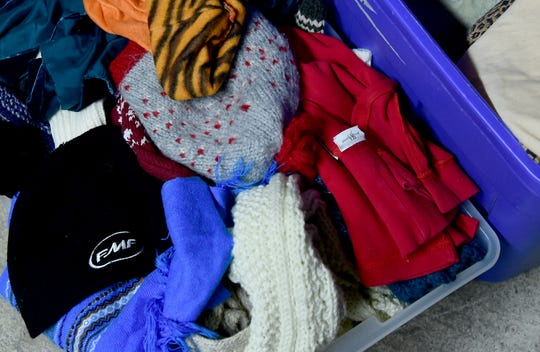 Donated hats and scarves at Catholic Charities of Tompkins/Tioga in Ithaca on Thursday, November 29, 2018.
