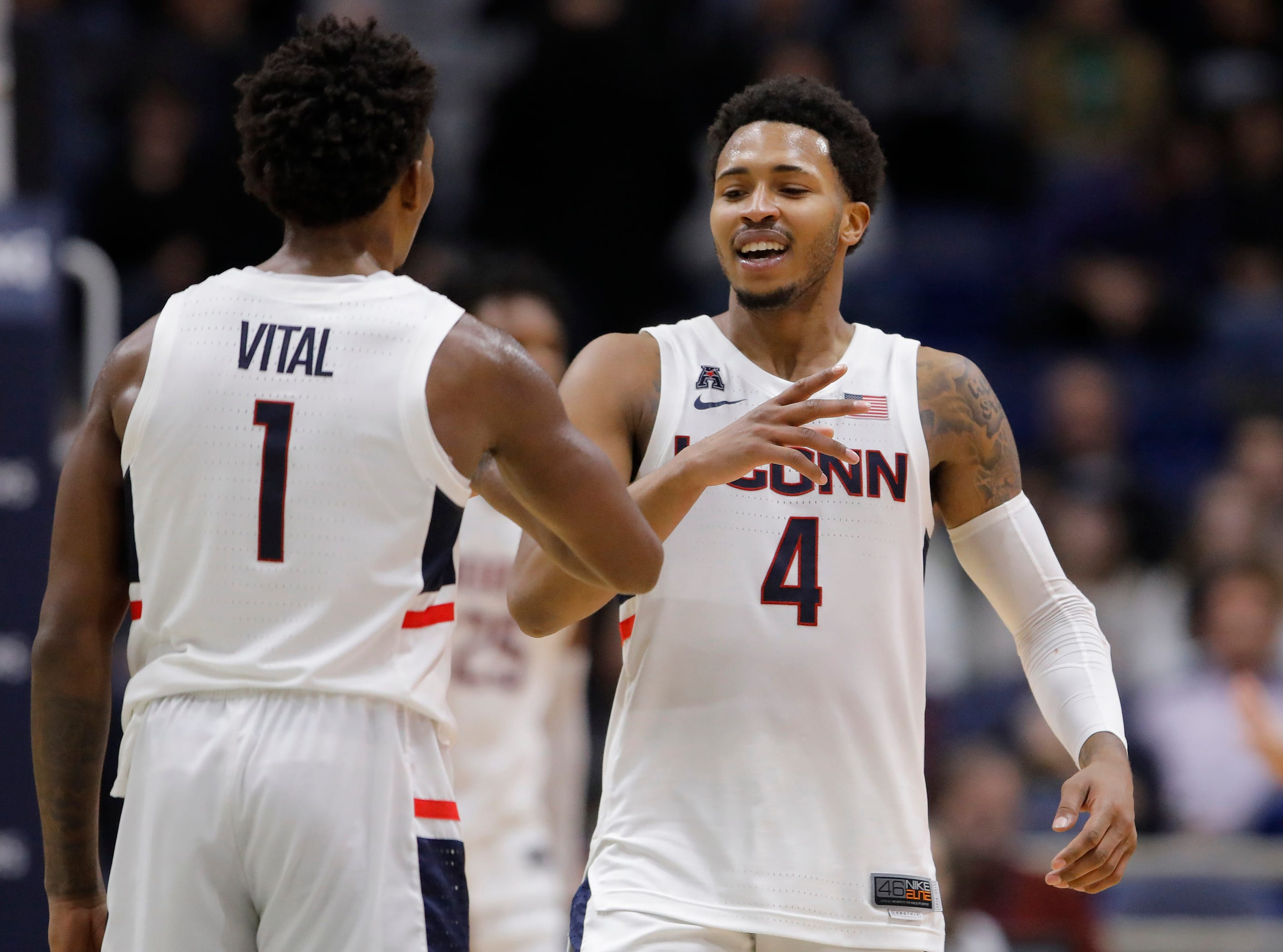 Nov 20, 2018; Storrs, CT, USA; Connecticut Huskies guard Jalen Adams (4) reacts with guard Christian Vital (1) after a play against the Cornell Big Red in the second half at XL Center. UConn defeated Cornell 91-74. Mandatory Credit: David Butler II-USA TODAY Sports