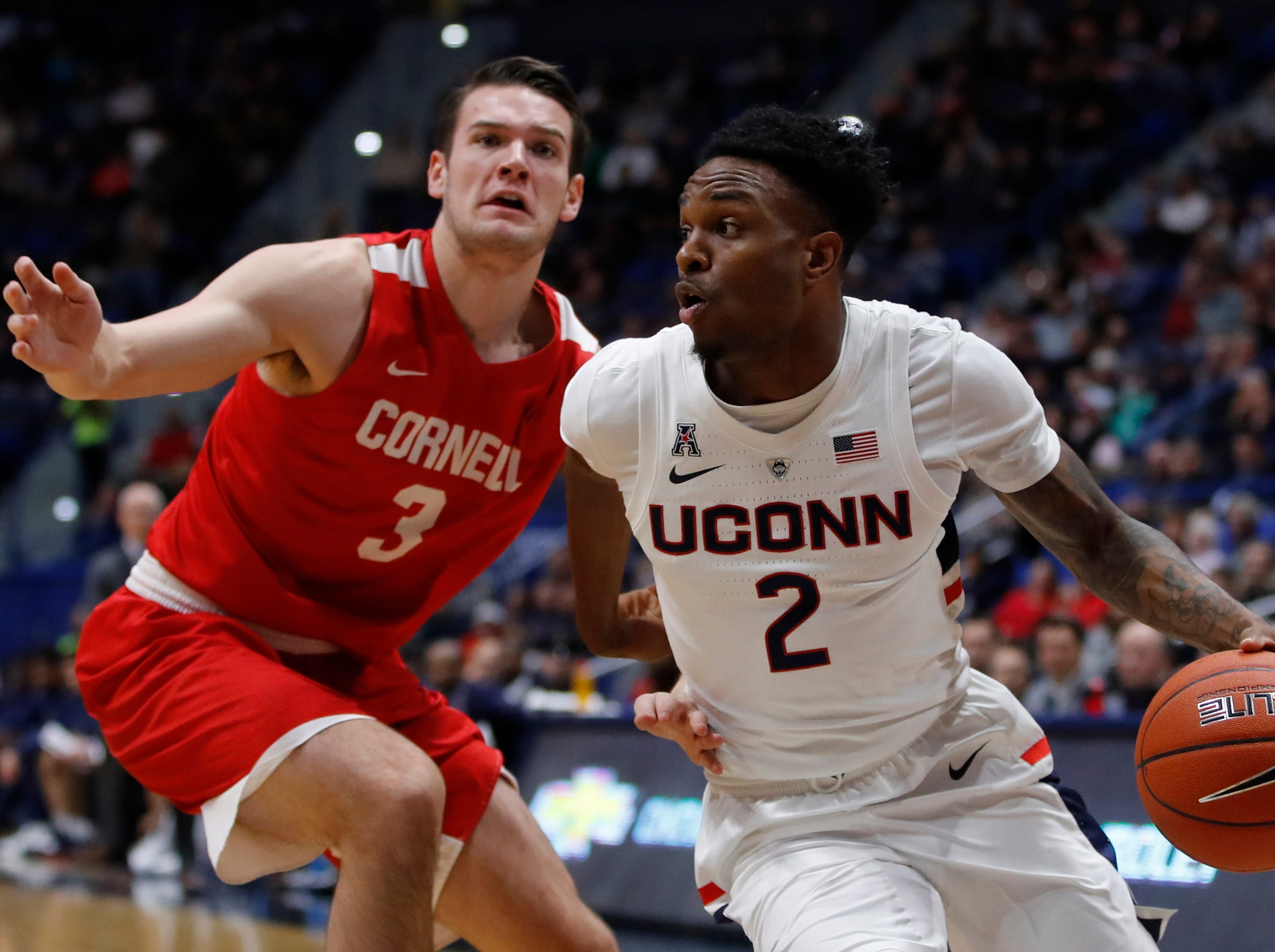 Nov 20, 2018; Storrs, CT, USA; Connecticut Huskies guard Tarin Smith (2) drives the ball against Cornell Big Red forward Jimmy Boeheim (3) in the first half at XL Center. Mandatory Credit: David Butler II-USA TODAY Sports