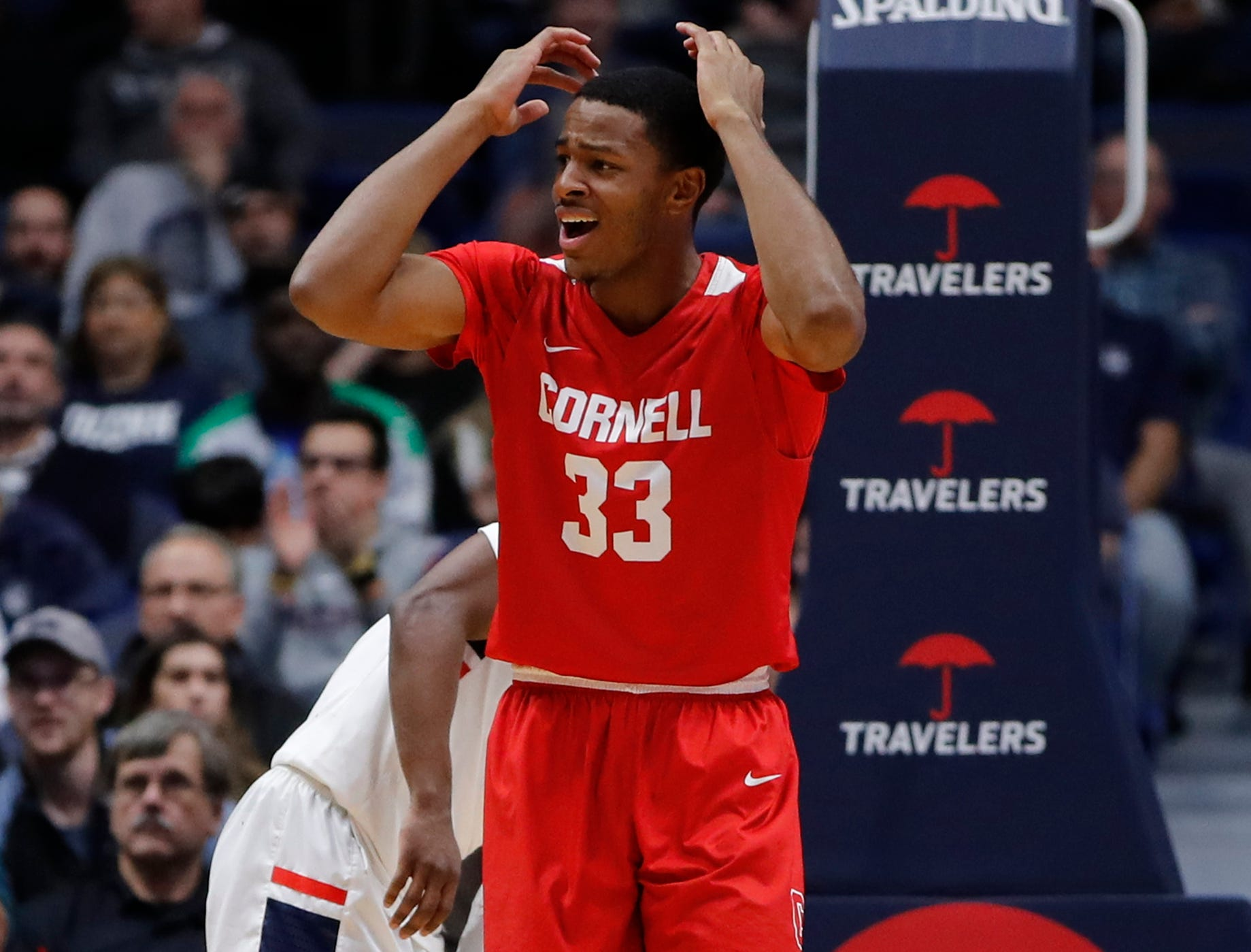 Nov 20, 2018; Storrs, CT, USA; Cornell Big Red forward Steven Julian (33) reacts after a call in the first half against the Connecticut Huskies at XL Center. Mandatory Credit: David Butler II-USA TODAY Sports