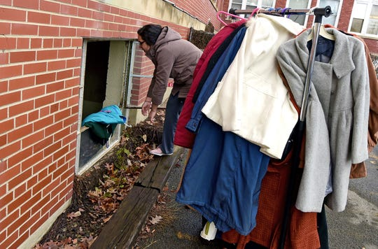 Volunteer Jessica Estrada helps organize winter clothing as Catholic Charities of Tompkins/Tioga staff and volunteers prepare winter clothing donations in Ithaca on Thursday, November 29, 2018.