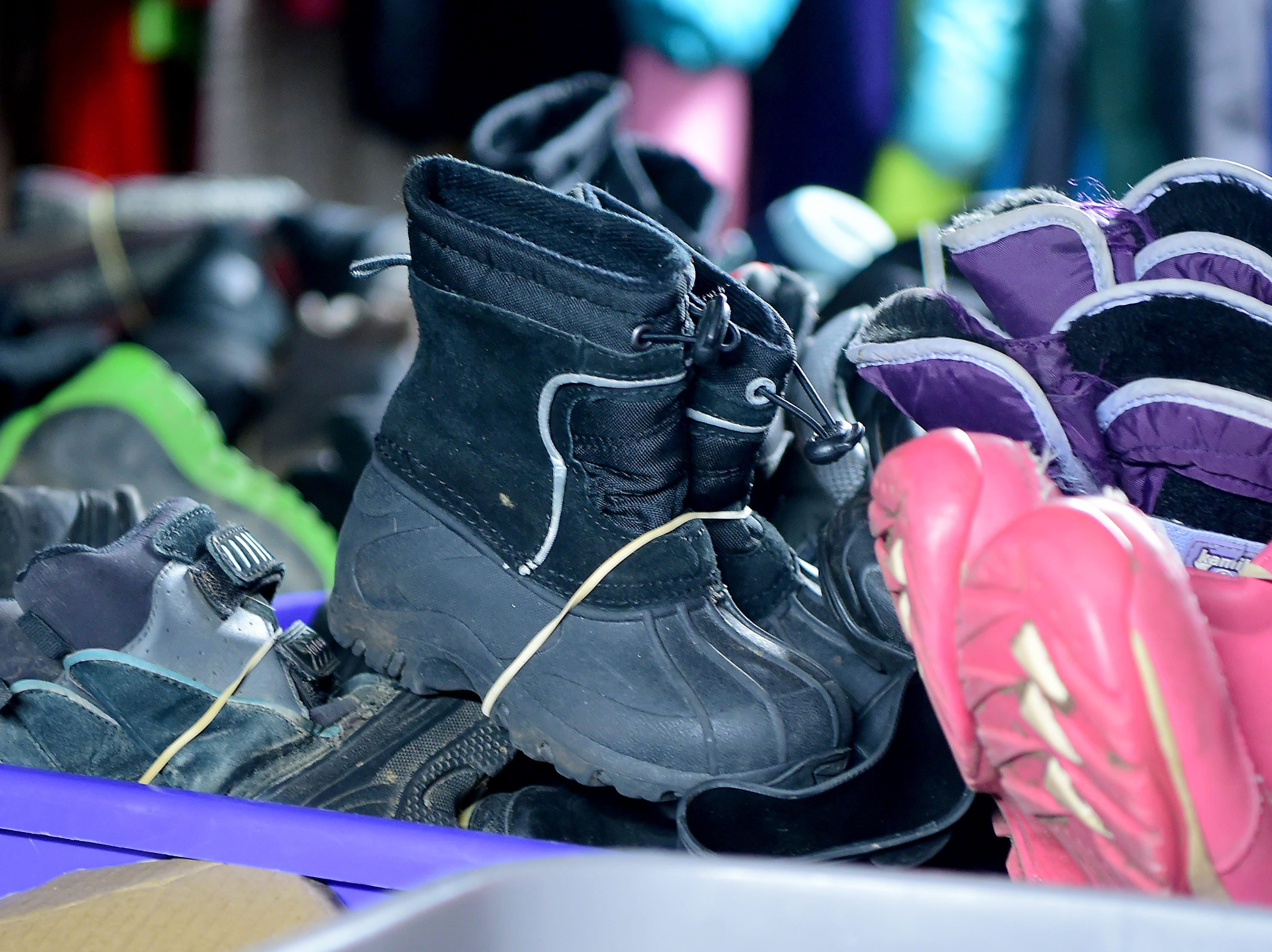 Donated kids boots at Catholic Charities of Tompkins/Tioga in Ithaca on Thursday, November 29, 2018.