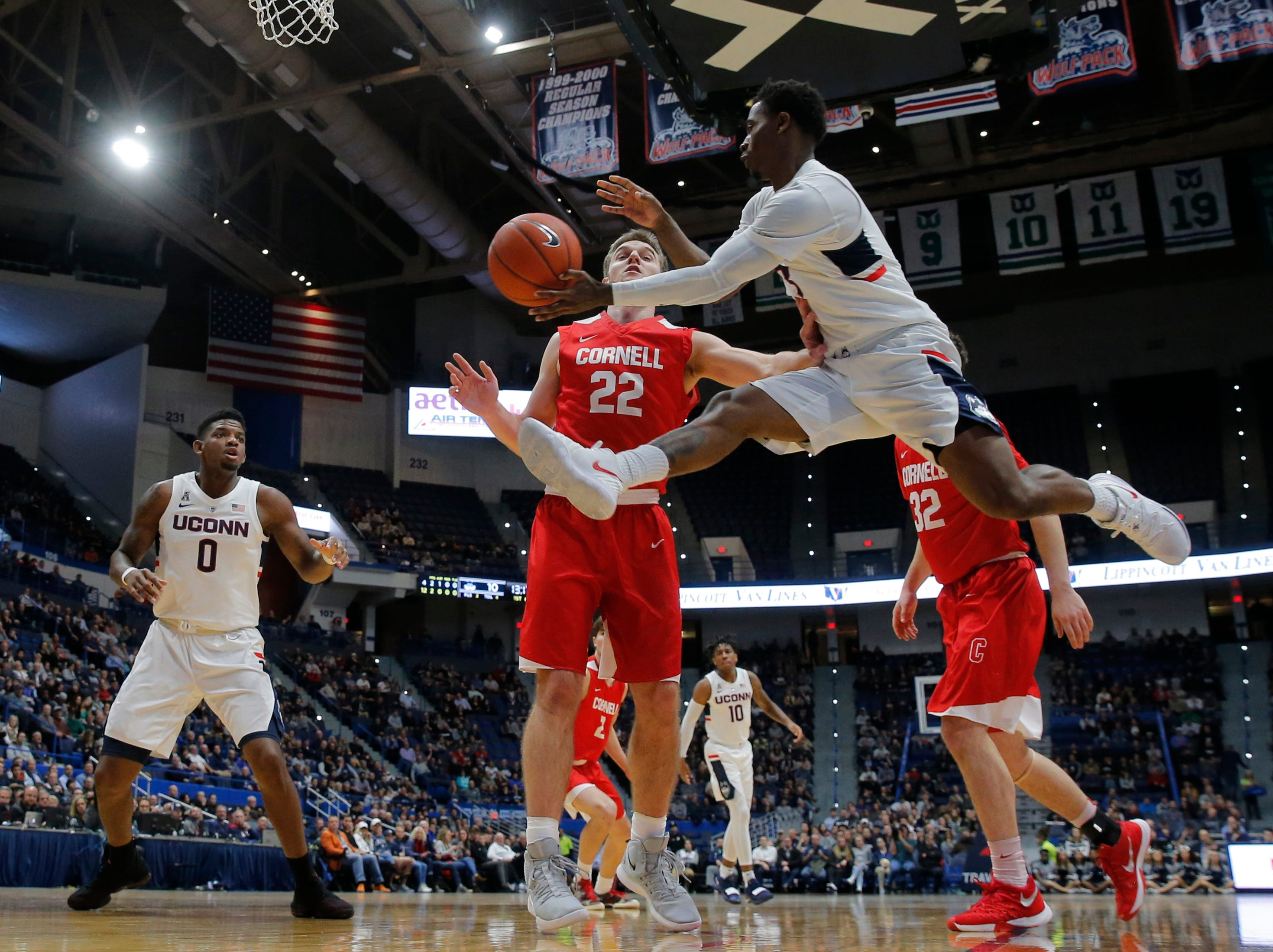 Nov 20, 2018; Storrs, CT, USA; Connecticut Huskies guard Alterique Gilbert (3) passes the ball against Cornell Big Red forward Josh Warren (22) in the first half at XL Center. Mandatory Credit: David Butler II-USA TODAY Sports