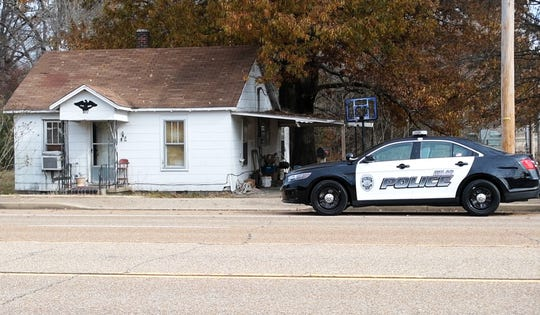 A Milan Police squad car sits outside the childhood home of missing woman Cayce McDaniel, Wednesday, November 28. FBI agents were called in to assist in the over 20 year old missing persons cold case of McDaniel by searching and collecting evidence in the home where it is reported she went missing from.