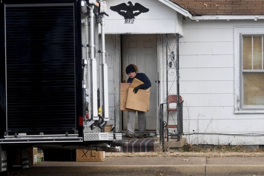 An FBI Evidence Response Team agent walks out the old home of Cayce McDaniel in Milan, Wednesday, November 28. Agents were called in to assist in the over 20 year old missing persons cold case of McDaniel by searching and collecting evidence in the home where it is reported she went missing from.