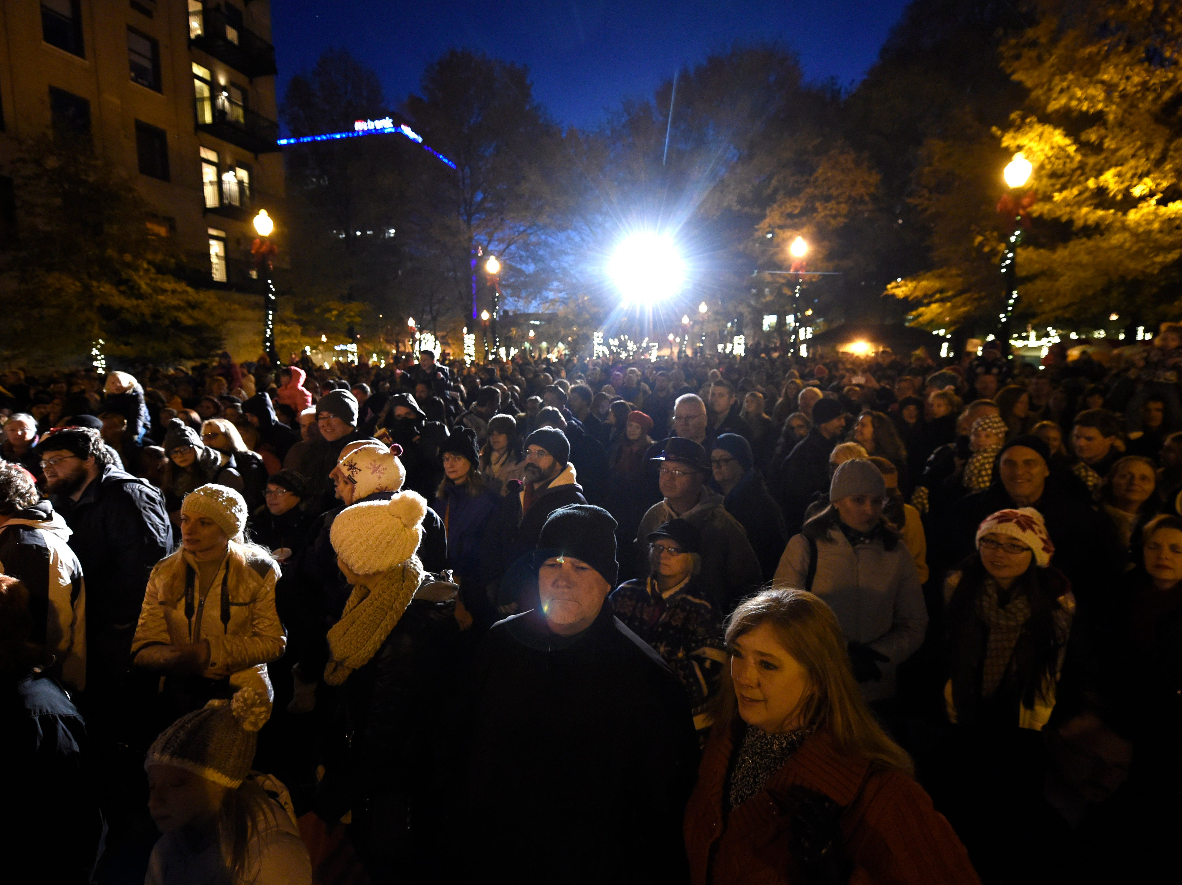 Spectators gather to watch the annual lighting of the Christmas tree in Krutch Park during Christmas in the City festivities in downtown Knoxville on Friday, Nov. 28, 2014.