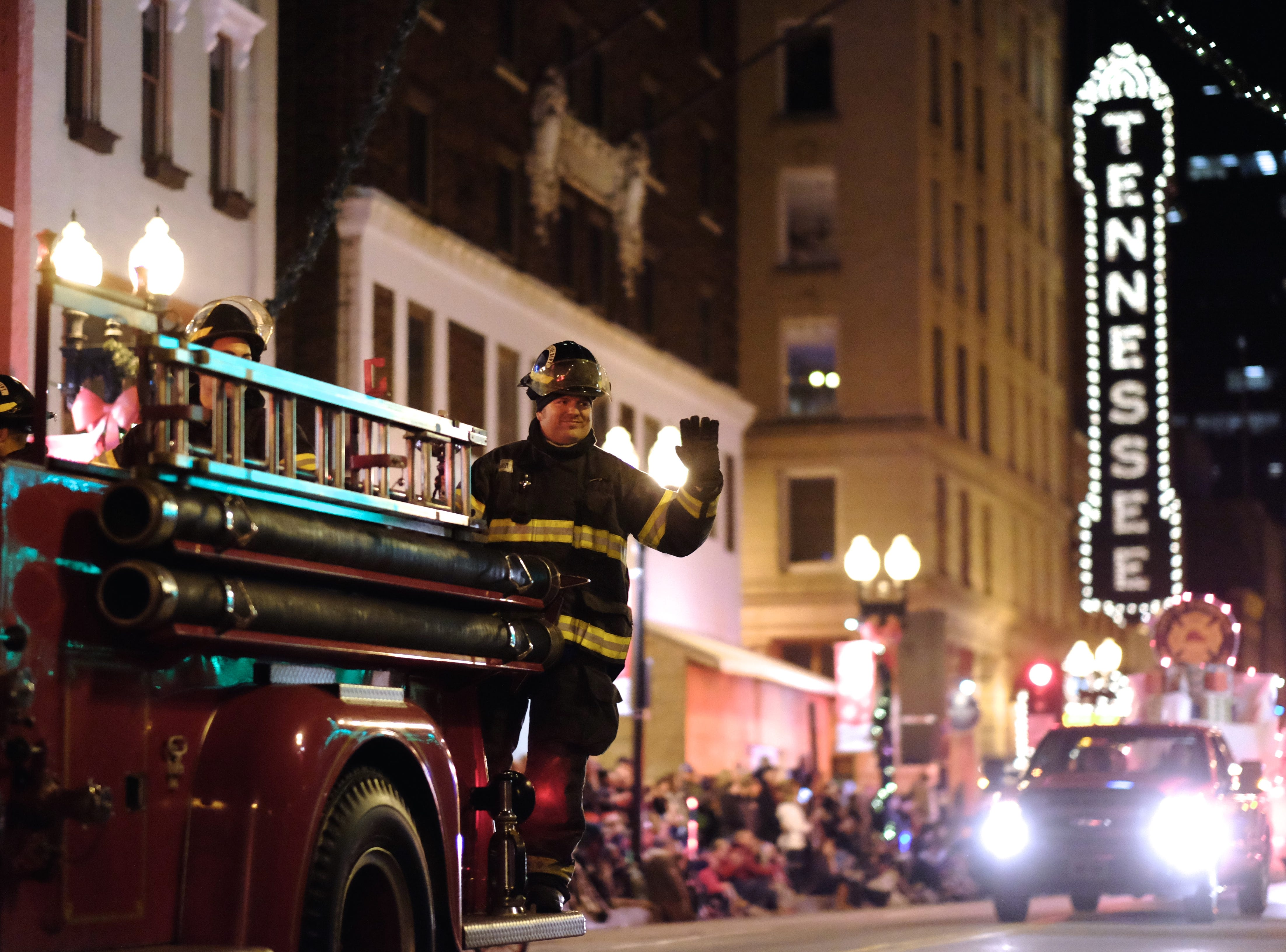 The Knoxville Fire Department cruises down Gay Street during the 43rd annual WIVK Christmas Parade on Friday, December 4, 2015, in Knoxville.